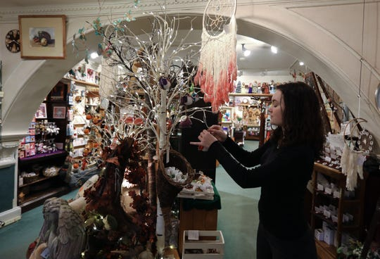 Una James works on a display at Hickory Dickory Dock on Broadway in Nyack Nov. 21, 2018.
