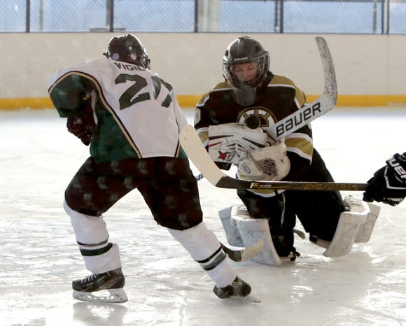 Yorktown/Brewster's Frankie Vigiletti is stopped by Clarkstown goalie Craig Kunz during their game at the Guy Mathews Invitational Thanksgiving Tournament at Ebersole Ice Rink Nov. 23, 2018.
