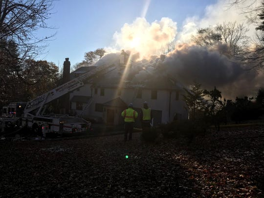 Smoke pours from 320 Elm Road in Briarcliff Manor after a fire broke out Friday, Nov. 23, 2018.