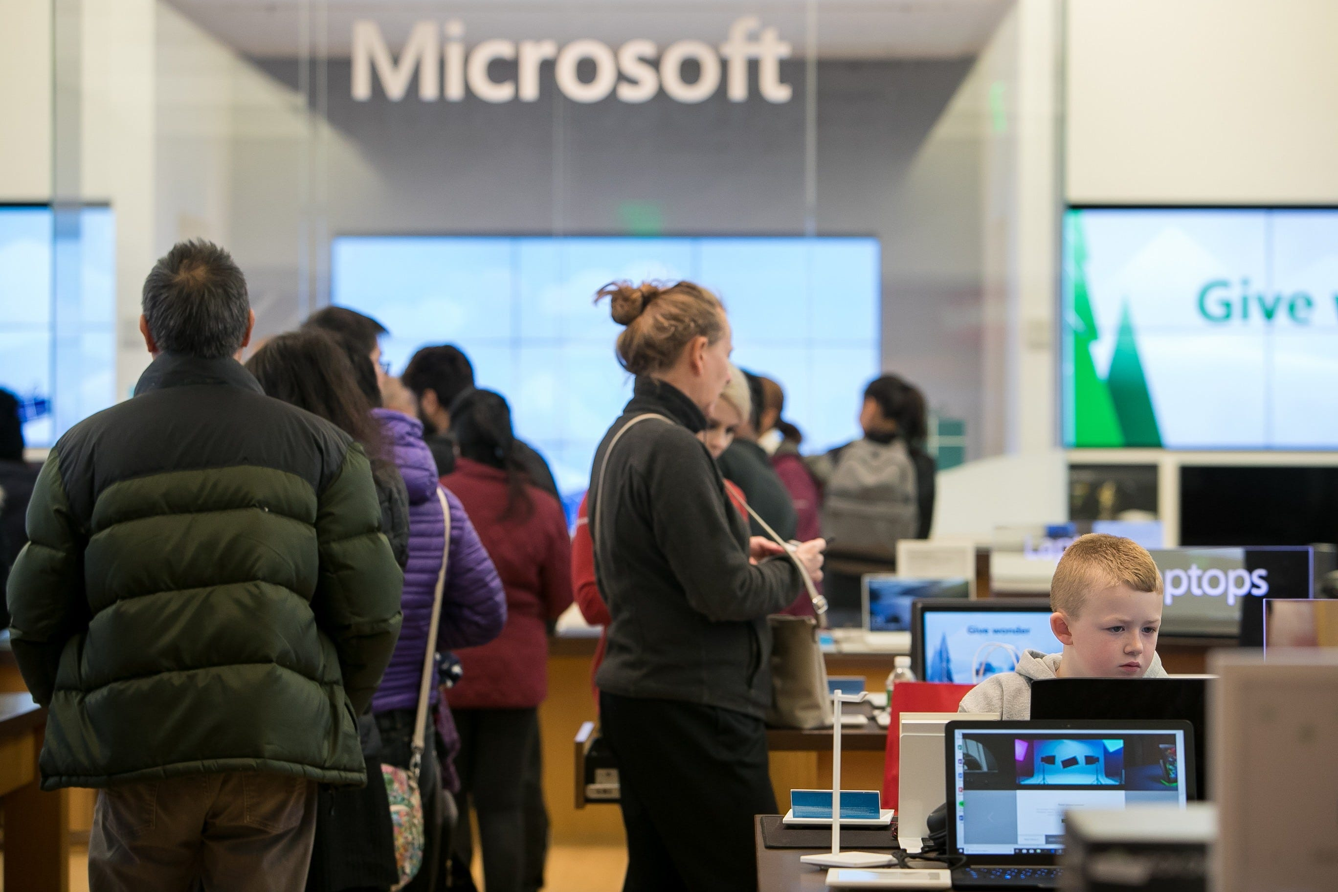 Shoppers look throughout the Microsoft retailer for offers at Christiana Mall on Dark Friday.
