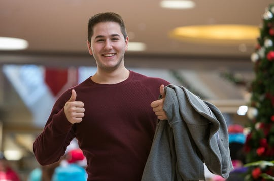 """Just trying to get some good deals"", says John Bagheri of Fallston, MD as he gives two thumbs up while he looks for deals at Christiana Mall on Black Friday."