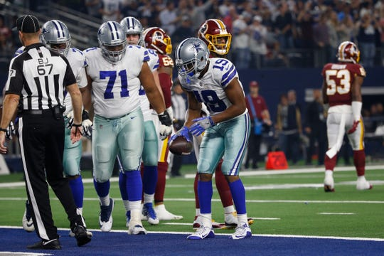 Dallas Cowboys wide receiver Amari Cooper (19) imitates the free throw form of embattled Sixers guard Markelle Fultz after scoring a touchdown against the Washington Redskins during the second half of an NFL football game in Arlington, Texas, Thursday, Nov. 22, 2018. (AP Photo/Ron Jenkins)