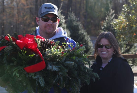 Herb and Bobbyjo Geissler of Newark leave Willey Farms with a Christmas wreath Friday morning.