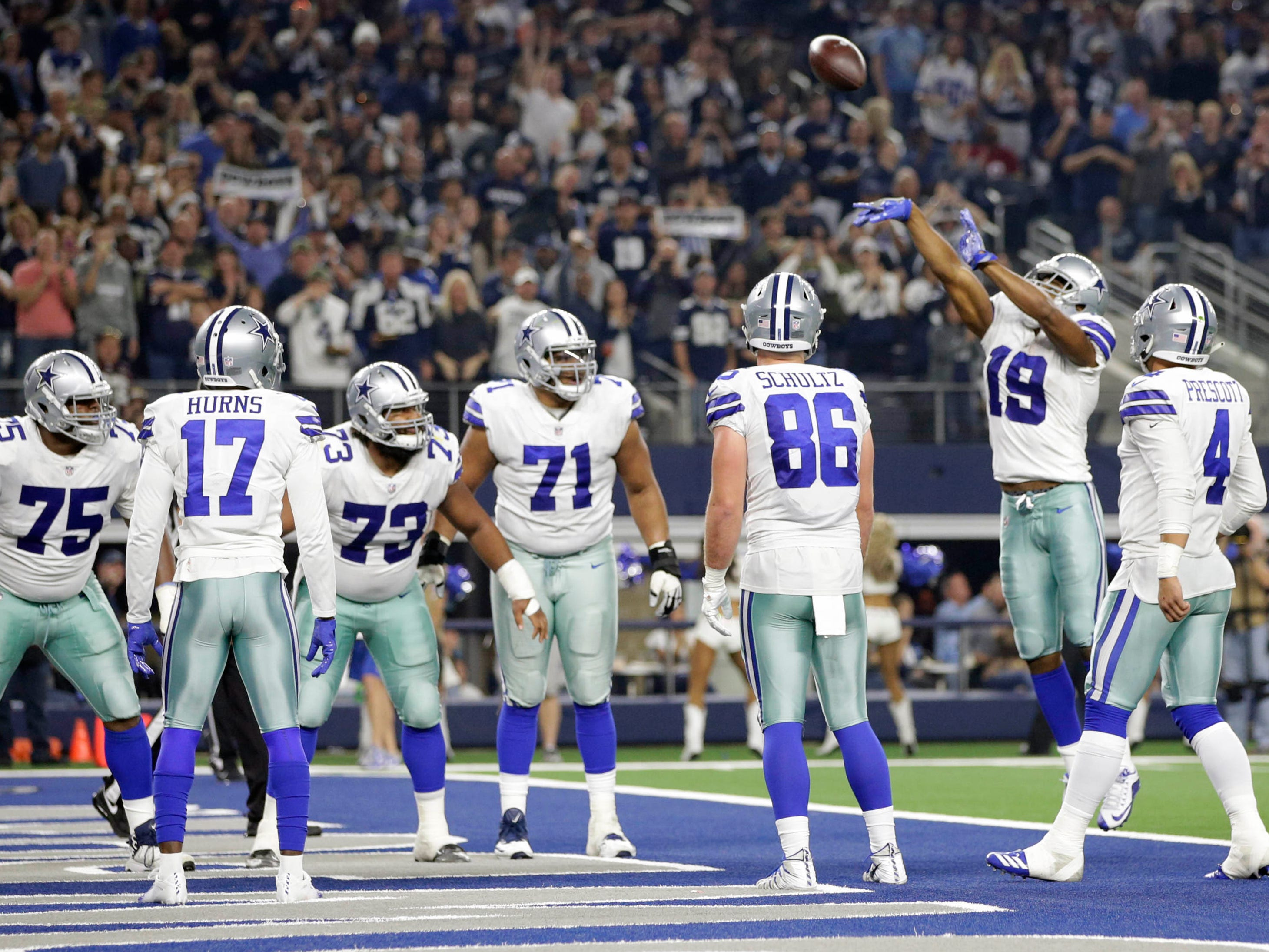 Cowboys receiver Amari Cooper (19) celebrated one of his two touchdowns against the Redskins with a Markelle Fultz-inspired free throw over the crossbar.