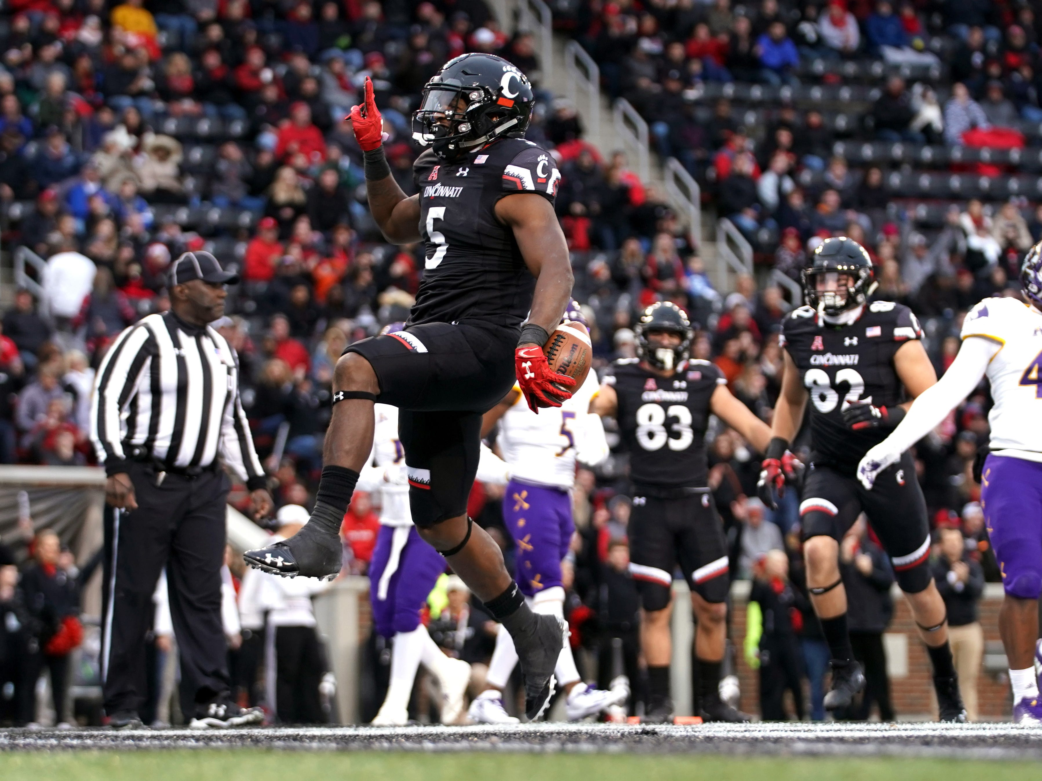 Cincinnati running back Tavion Thomas celebrates after scoring a touchdown against East Carolina.