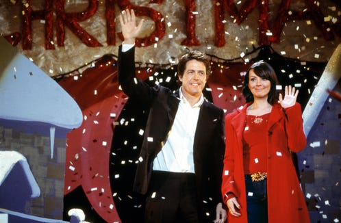 "The British prime minister (Hugh Grant) and his staffer, Natalie (Martine McCutcheon), comprise one of many couples in the Christmas rom-com ""Love Actually."""