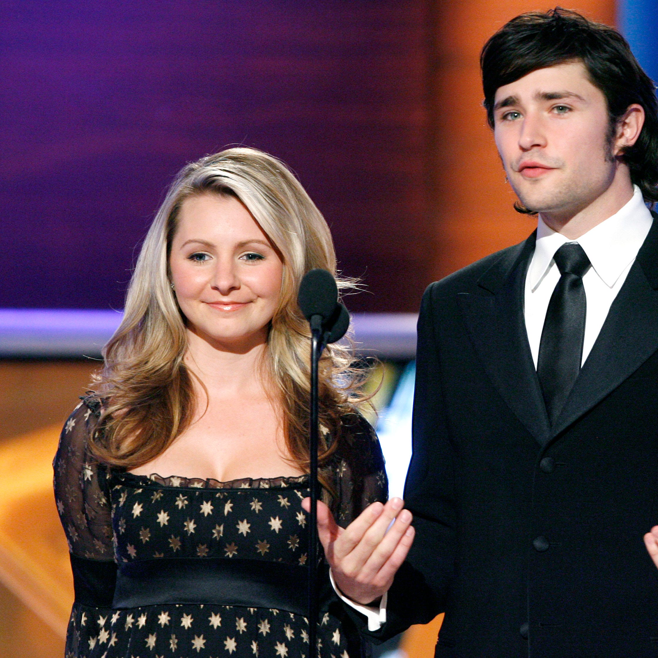 Actors Beverley Mitchell, left, and Matt Dallas present the award for Favorite Father/Daughter at the Family Television Awards in Beverly Hills, Calif., on Wednesday, Nov. 29, 2006. (AP Photo/Matt Sayles) ORG XMIT: CAMW113