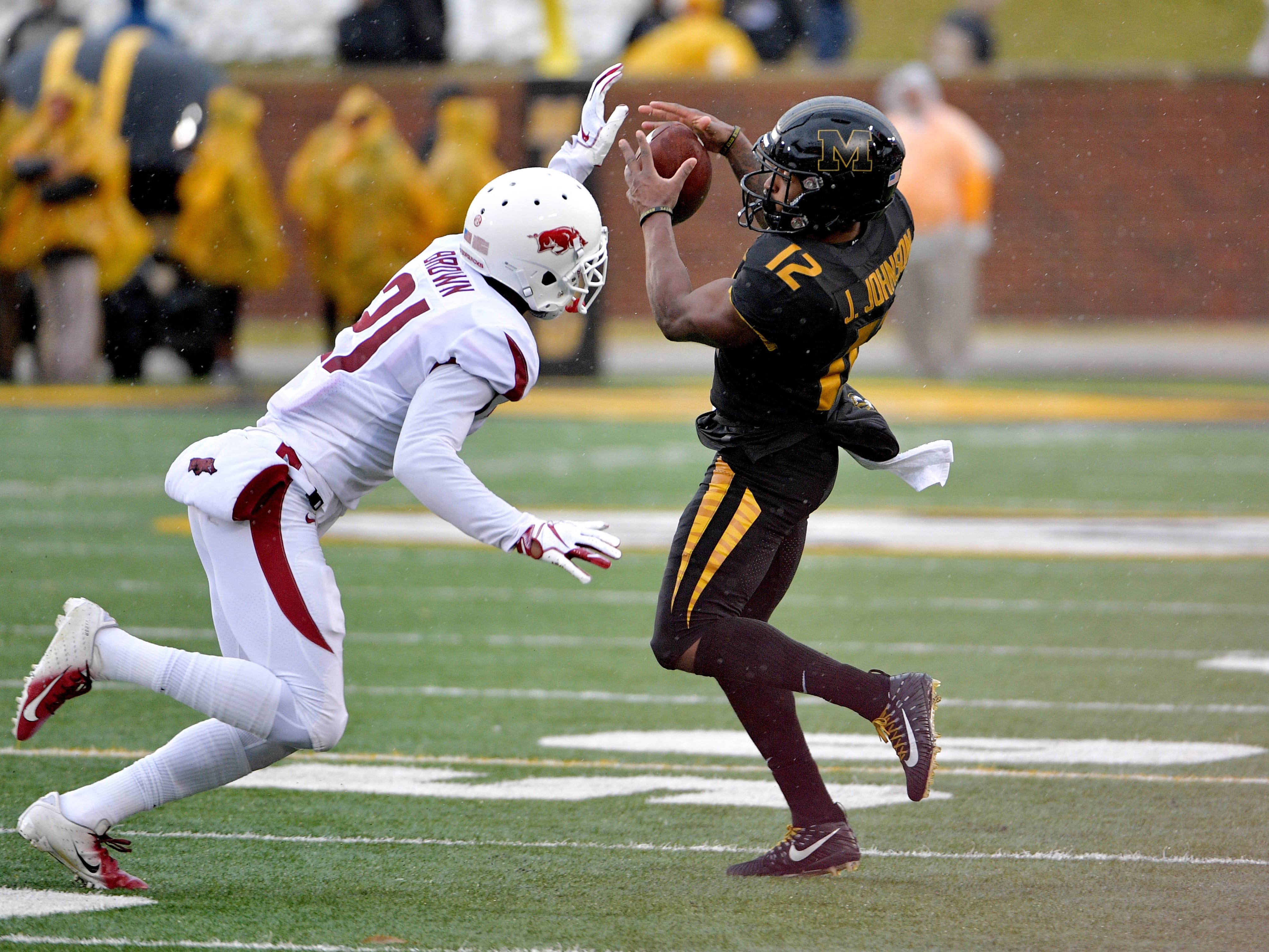 Missouri wide receiver Johnathon Johnson catches a pass against Arkansas defensive back Montaric Brown during the first half.