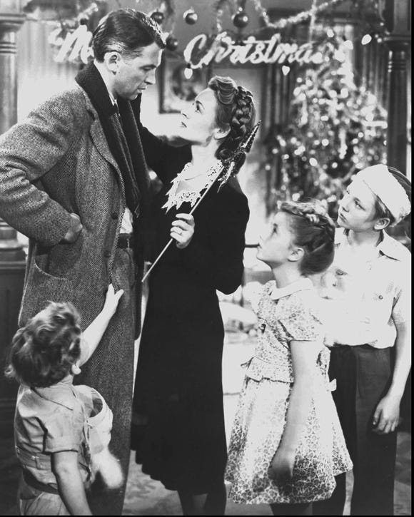 "George Bailey (Jimmy Stewart, top left) celebrates Christmas with his wife (Donna Reed) and kids (Larry Simms, Carol Coomes and Jimmy Hawkins) in ""It's a Wonderful Life."""