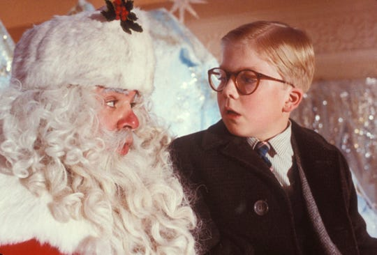 "A mall Santa (Jeff Gillen, left) makes Raphie (Peter Billingsley) nervous in ""A Christmas Story."""