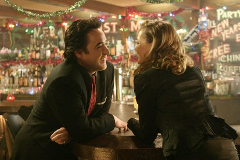 "John Cusack (left, with Connie Nielsen) is a mob lawyer trying to get out of town with a bunch of stolen loot in ""The Ice Harvest."""