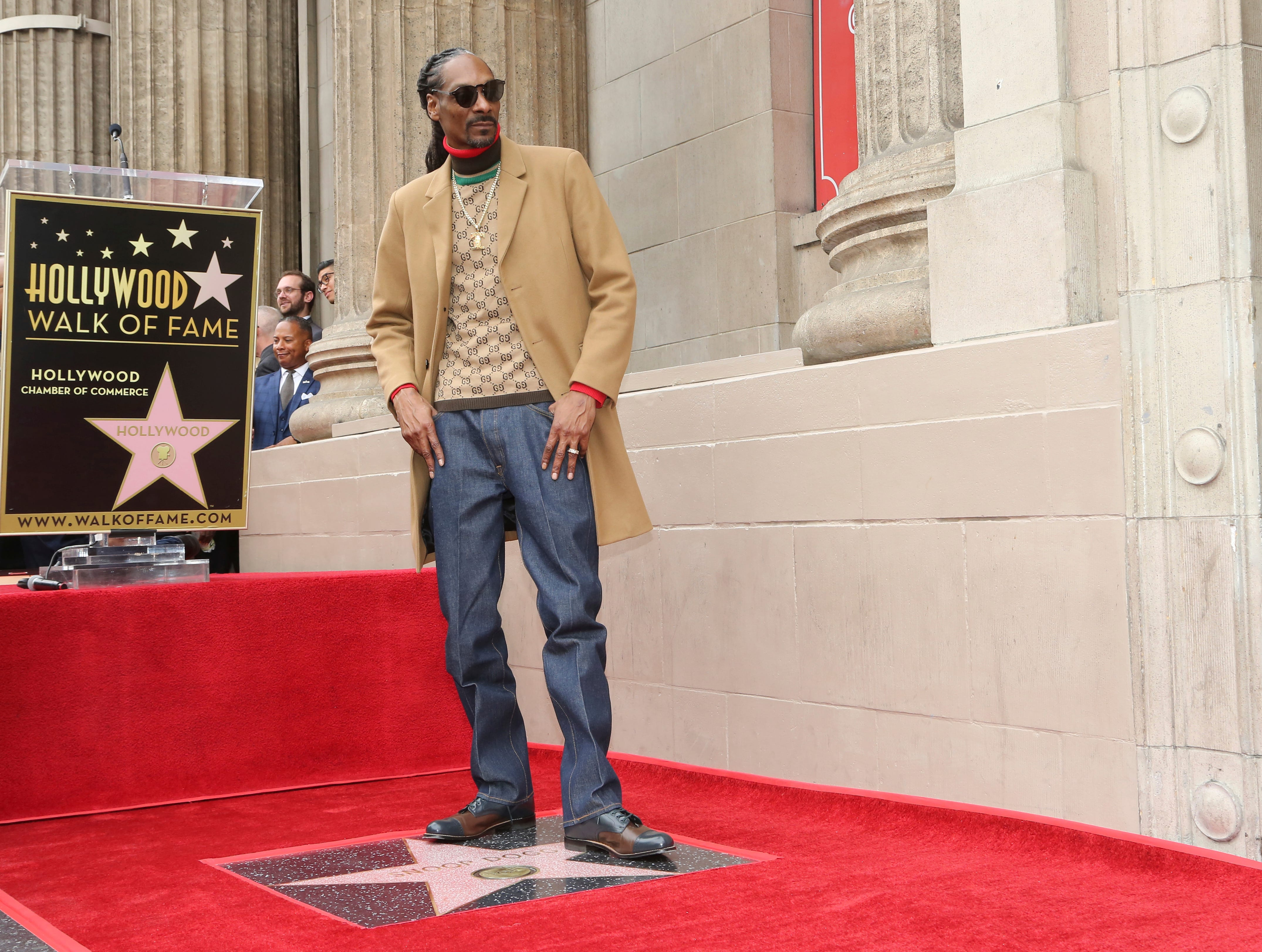 Rapper Snoop Dogg poses atop his new star on the Hollywood Walk of Fame following a ceremony in his honor on Monday, Nov. 19, 2018, in Los Angeles. (Photo by Willy Sanjuan/Invision/AP) ORG XMIT: CAPM105