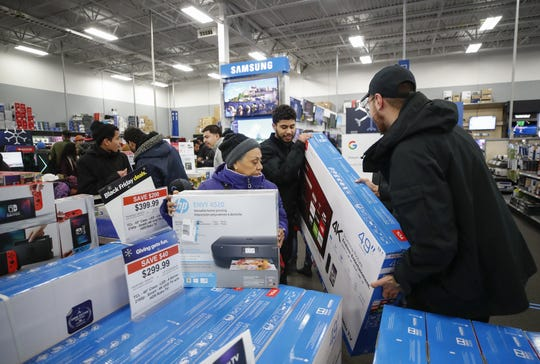 Shoppers pick out flat screen TVs at a Best Buy Inc. store on Nov. 22, 2018 in Chicago.