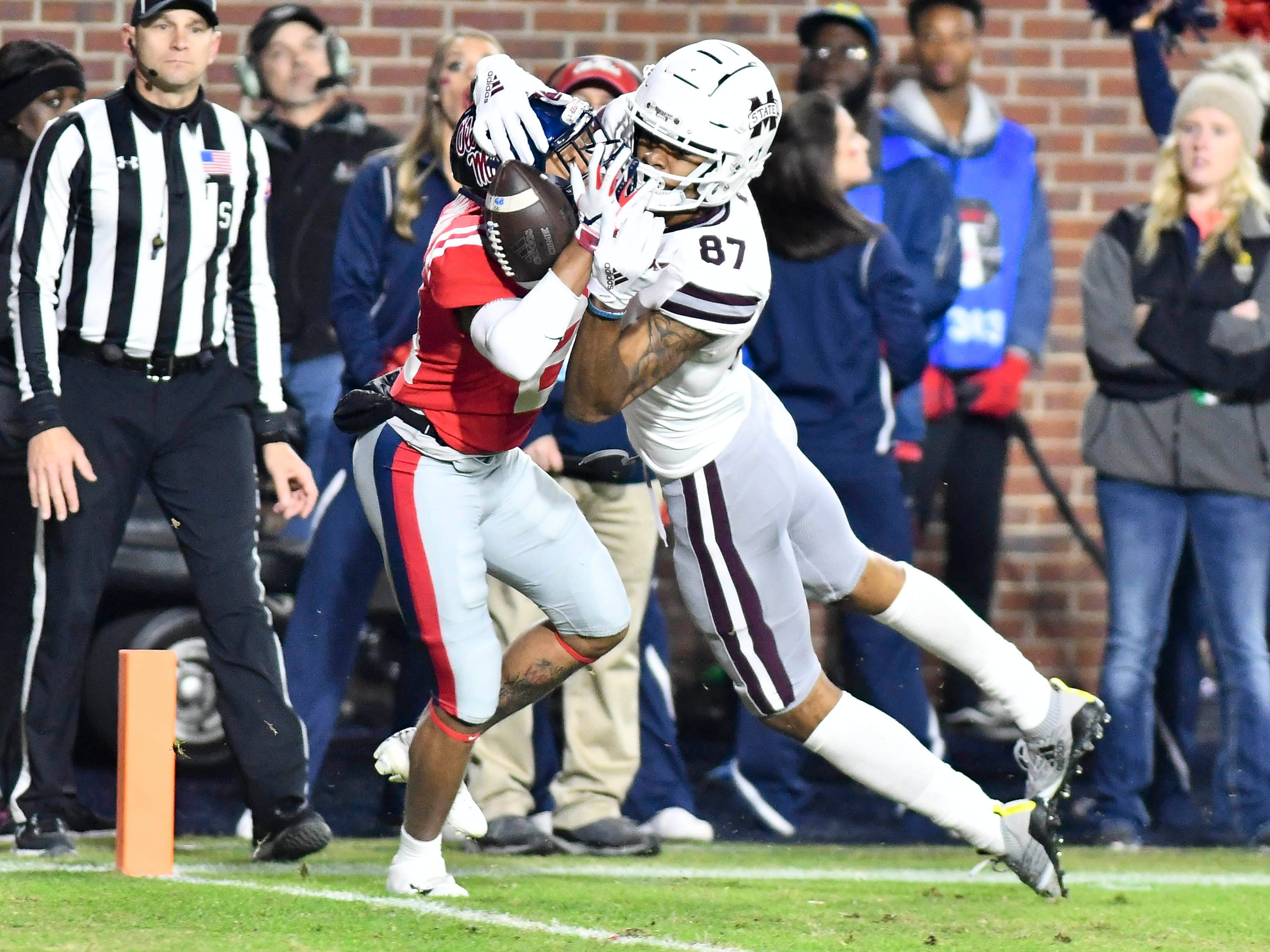 Mississippi State wide receiver Osirus Mitchell (87) fights with Mississippi defensive back Javien Hamilton for a catch during the second quarter at Vaught-Hemingway Stadium.
