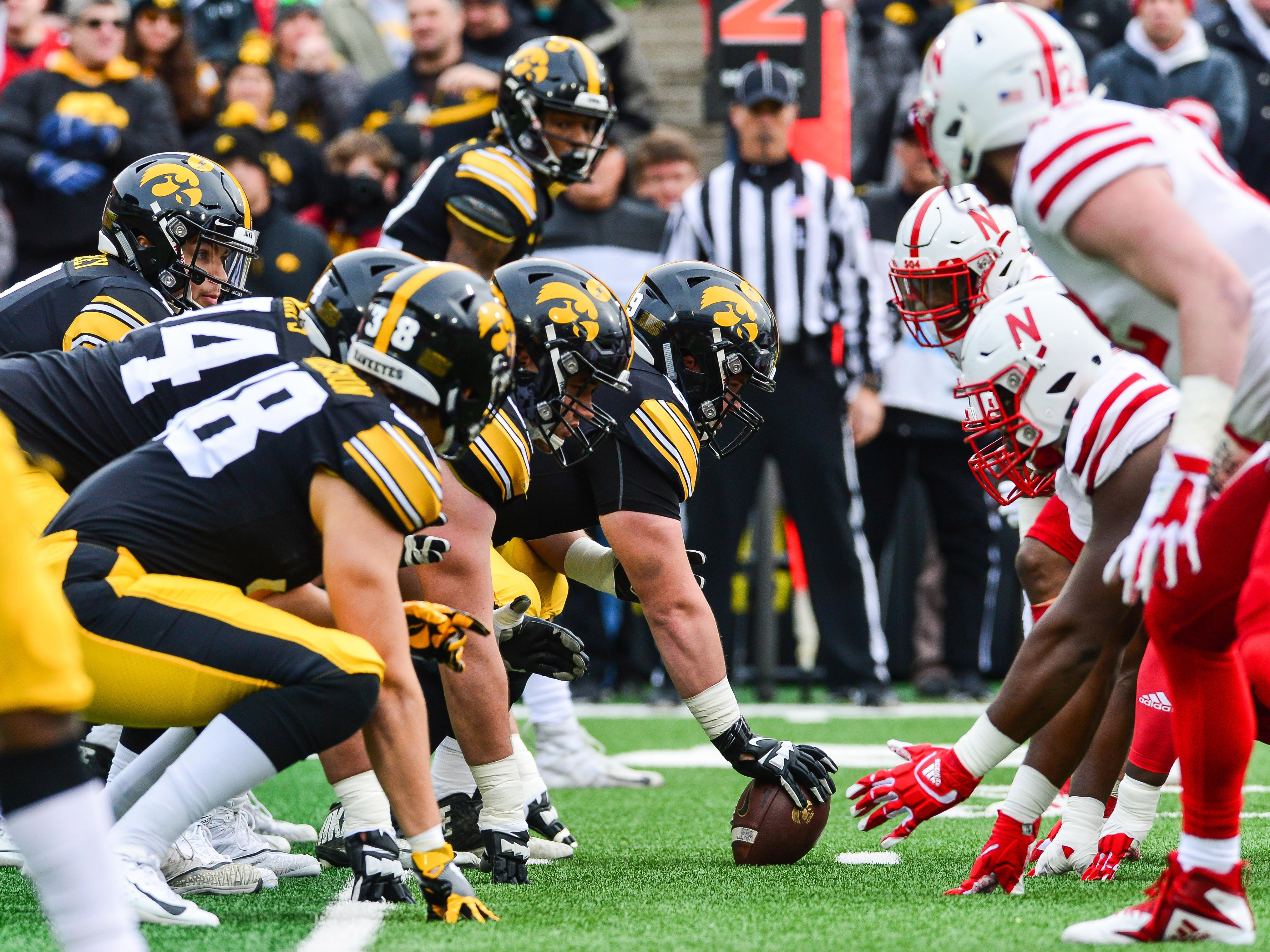 Iowa quarterback Nate Stanley looks over the line of scrimmage before taking a snap during the first quarter against Nebraska.