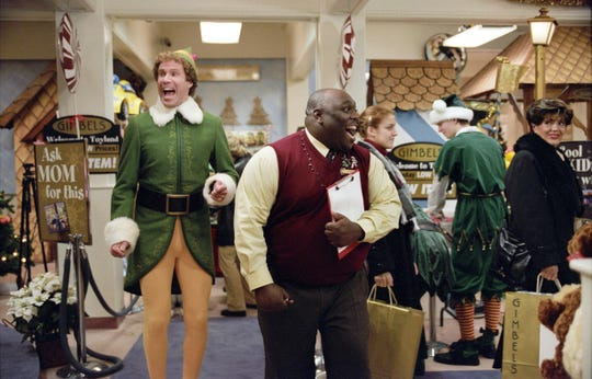 "Buddy the elf (Will Ferrell, left, with Faizon Love) is excited for Santa in a scene from ""Elf."""