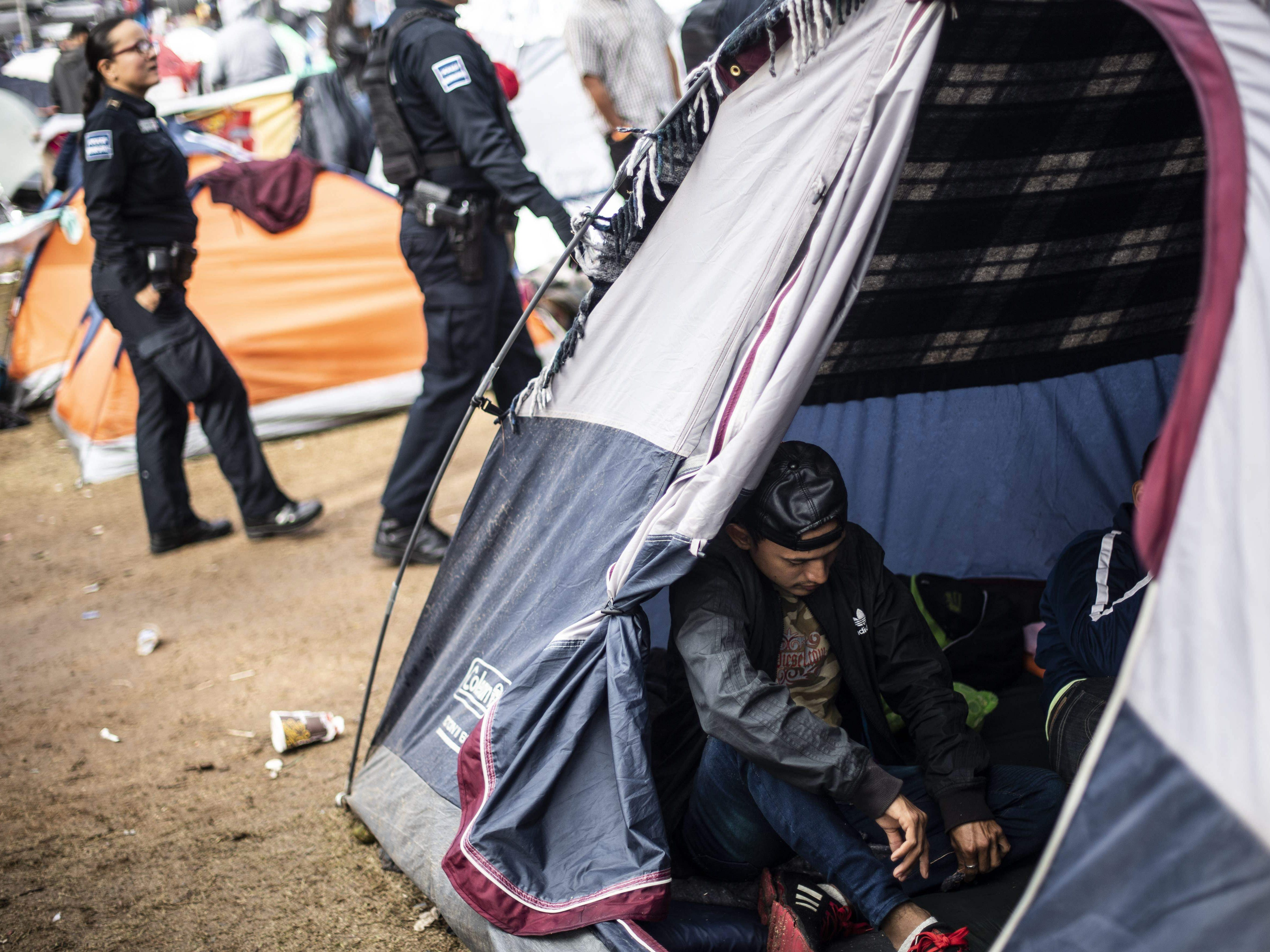 Central American migrants rest at a shelter near the U.S.-Mexico border fence in Tijuana, Baja California state, Mexico, on Nov. 22, 2018.