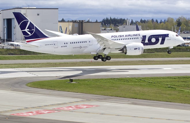 A LOT Polish Airlines Boeing 787 Dreamliner lands after a certification flight April 5, 2013 at Paine Field in Everett, Washington.
