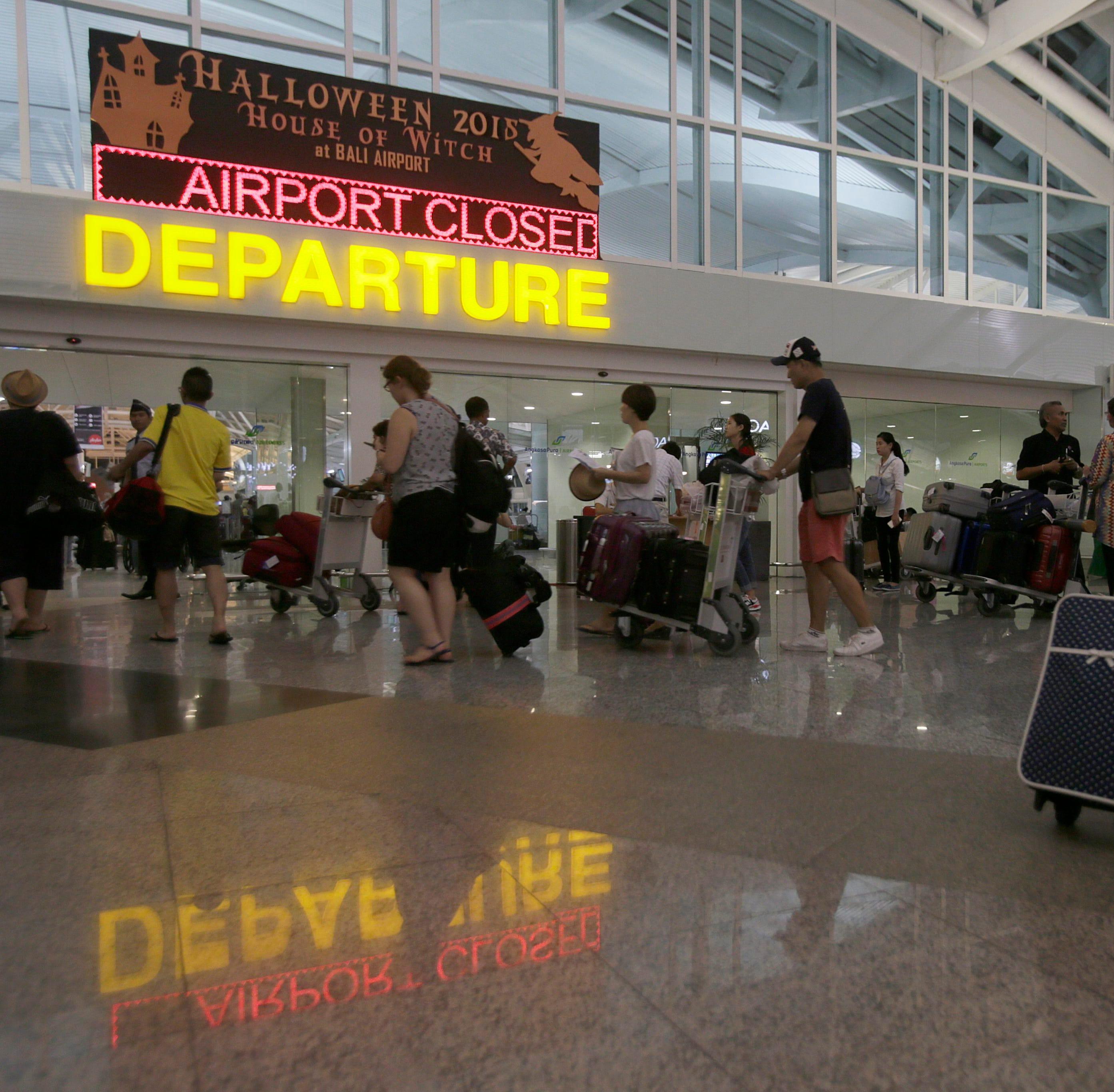 Passengers wait for their delayed flights at Bali's Ngurah Rai International Airport in Bali, Indonesia on Nov. 3, 2015.
