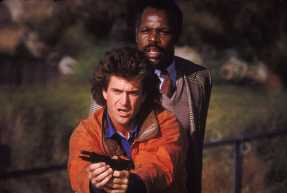 "Mel Gibson (left) and Danny Glover are reluctant partners in the Christmas-themed action film ""Lethal Weapon."""