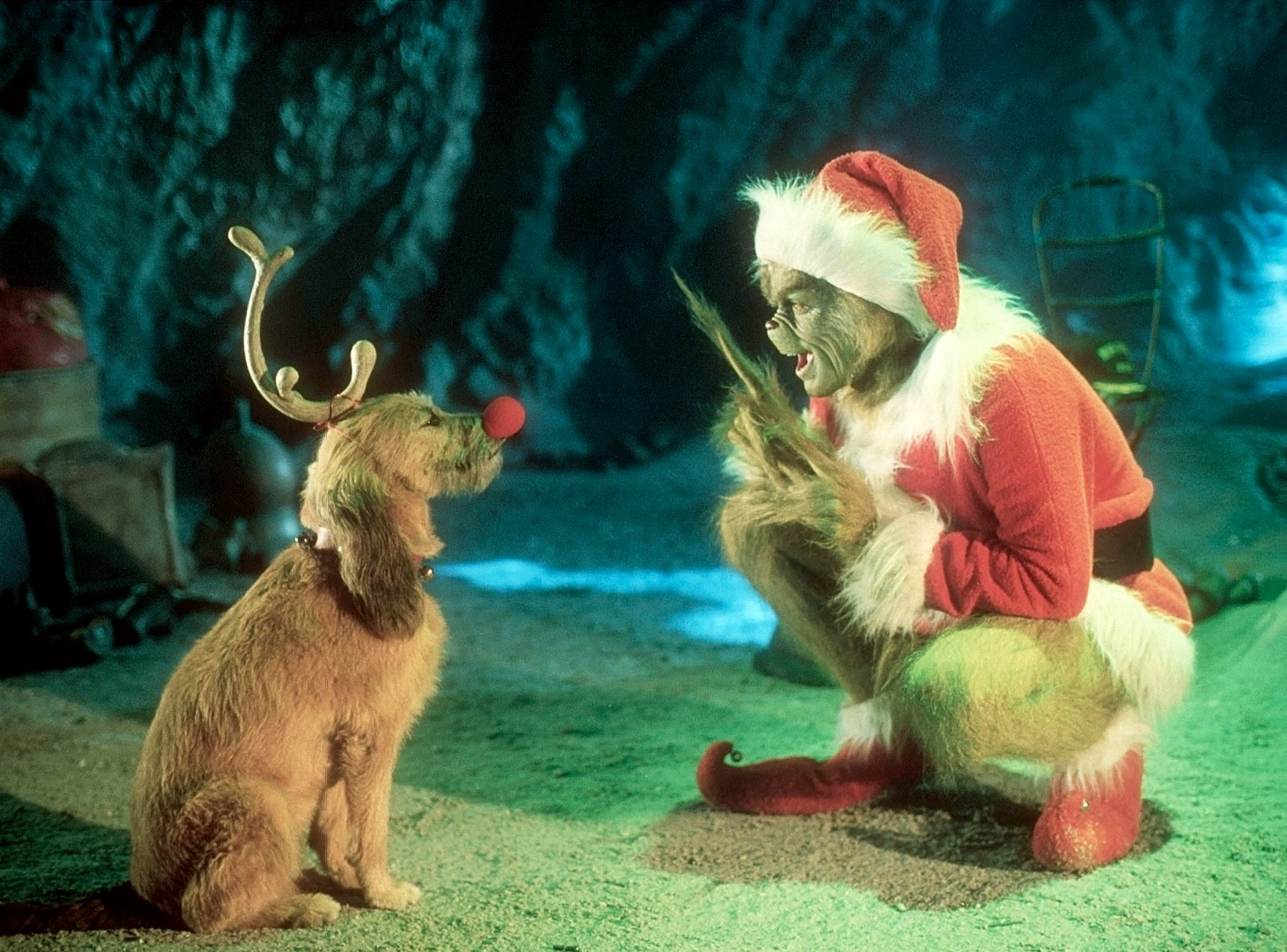 "Jim Carrey, as the Grinch, with Max, in a scene from 2000's ""How The Grinch Stole Christmas."""