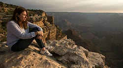 Laura Trujillo of Cincinnati, Ohio, looks out from the Trailview Overlook on the south rim of the Grand Canyon in Grand Canyon National Park, Ariz., on August 3, 2018. Trujillo's mother, Elizabeth Miller, committed suicide by jumping off the Trailview Overlook in April 2012.  (Via OlyDrop)