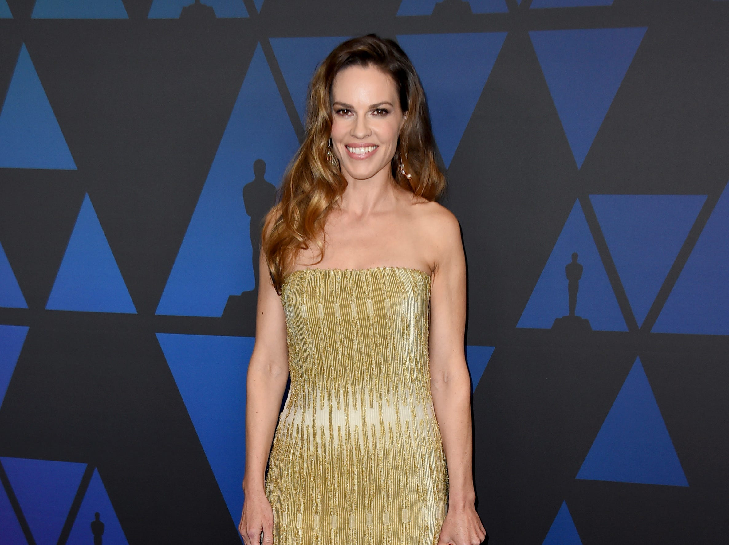Hilary Swank arrives at the Governors Awards on Sunday, Nov. 18, 2018, at the Dolby Theatre in Los Angeles. (Photo by Jordan Strauss/Invision/AP) ORG XMIT: CAPM162