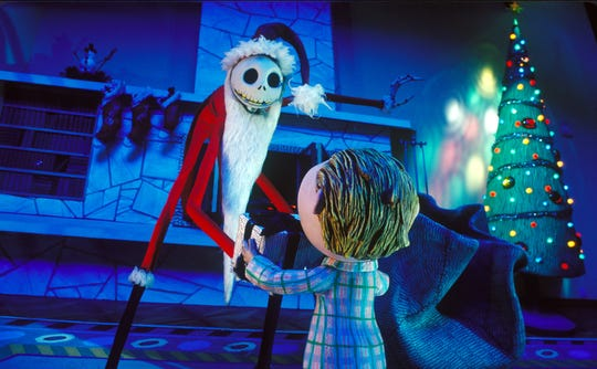 "Jack Skellington (voiced by Chris Sarandon) takes on the role of Santa Claus in Tim Burton's ""The Nightmare Before Christmas."""