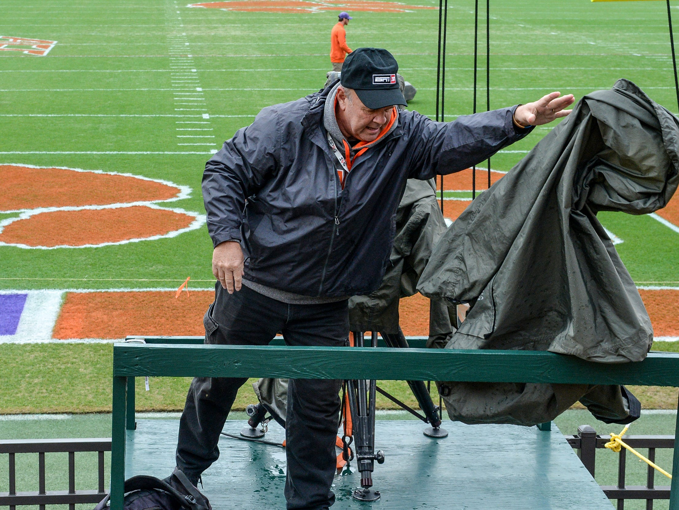 Bob Schuster, an ESPN television cameraman from Anderson County, tosses a rain cover to the side as he gets ready hours before kickoff inside Memorial Stadium, before the South Carolina at Clemson football game, in Clemson on Saturday, November 24, 2018.
