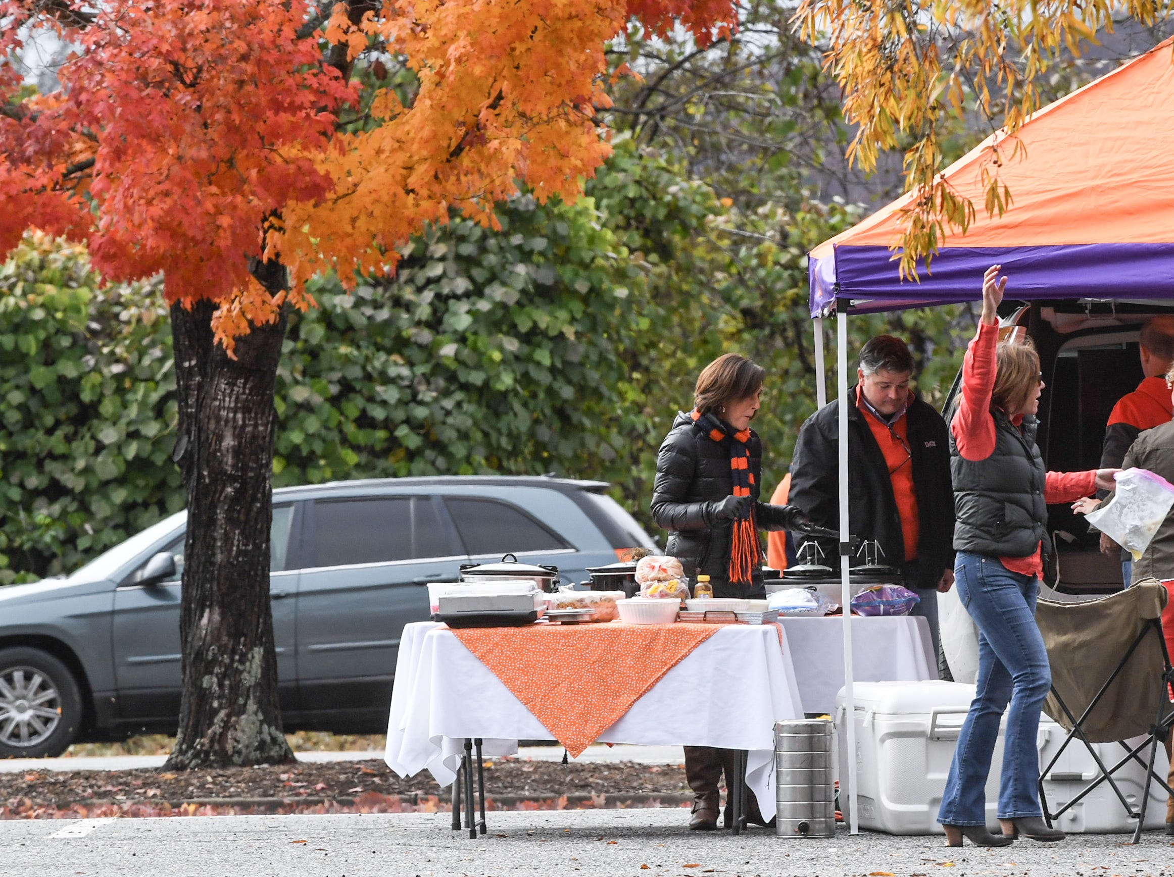 Fans tailgate hours before kickoff outside Memorial Stadium, before the South Carolina at Clemson football game in Clemson on Saturday, November 24, 2018.