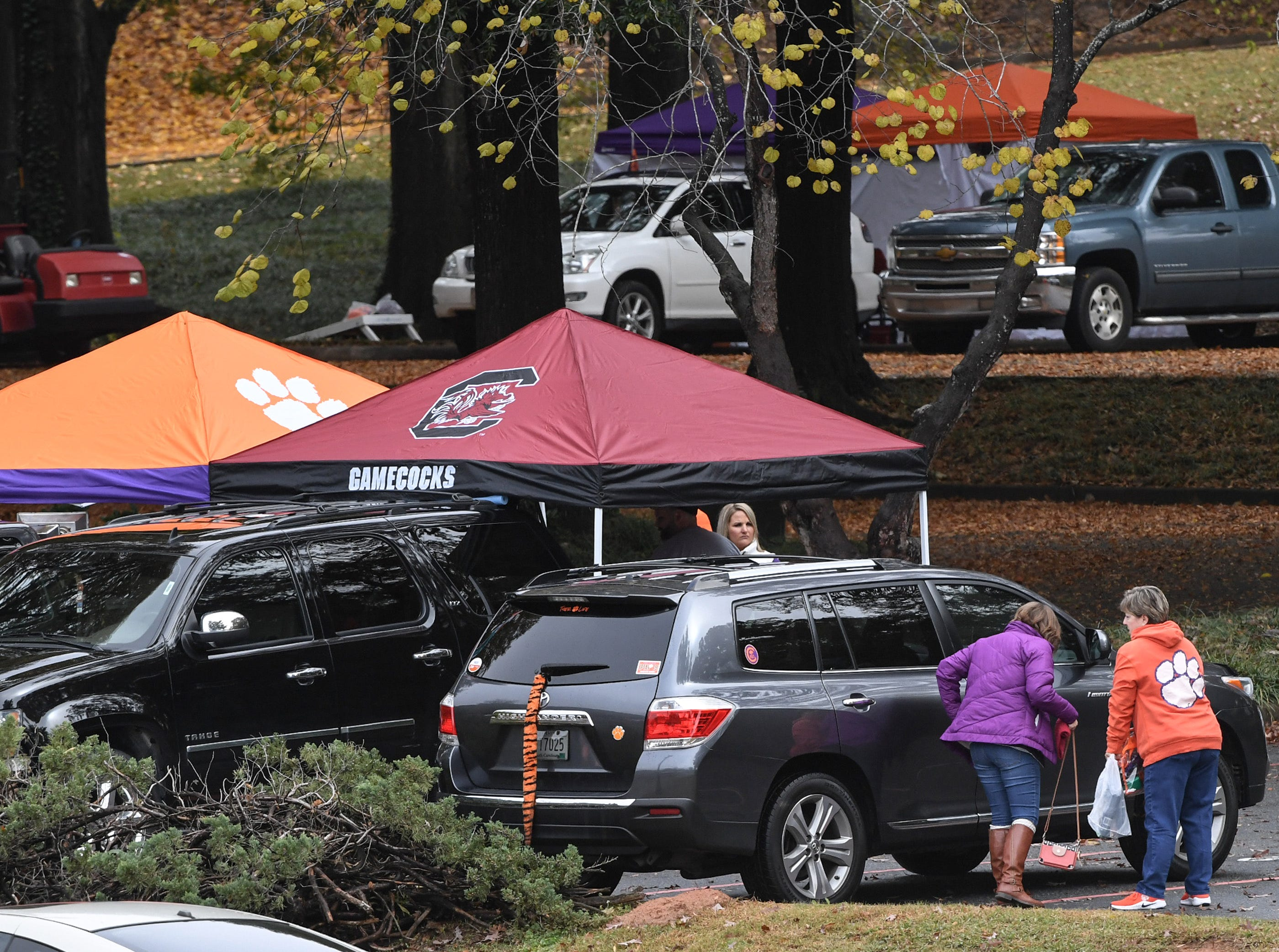 Fans from USC and Clemson tailgate hours before kickoff outside Memorial Stadium, before the rivalry game in Clemson on Saturday, November 24, 2018.