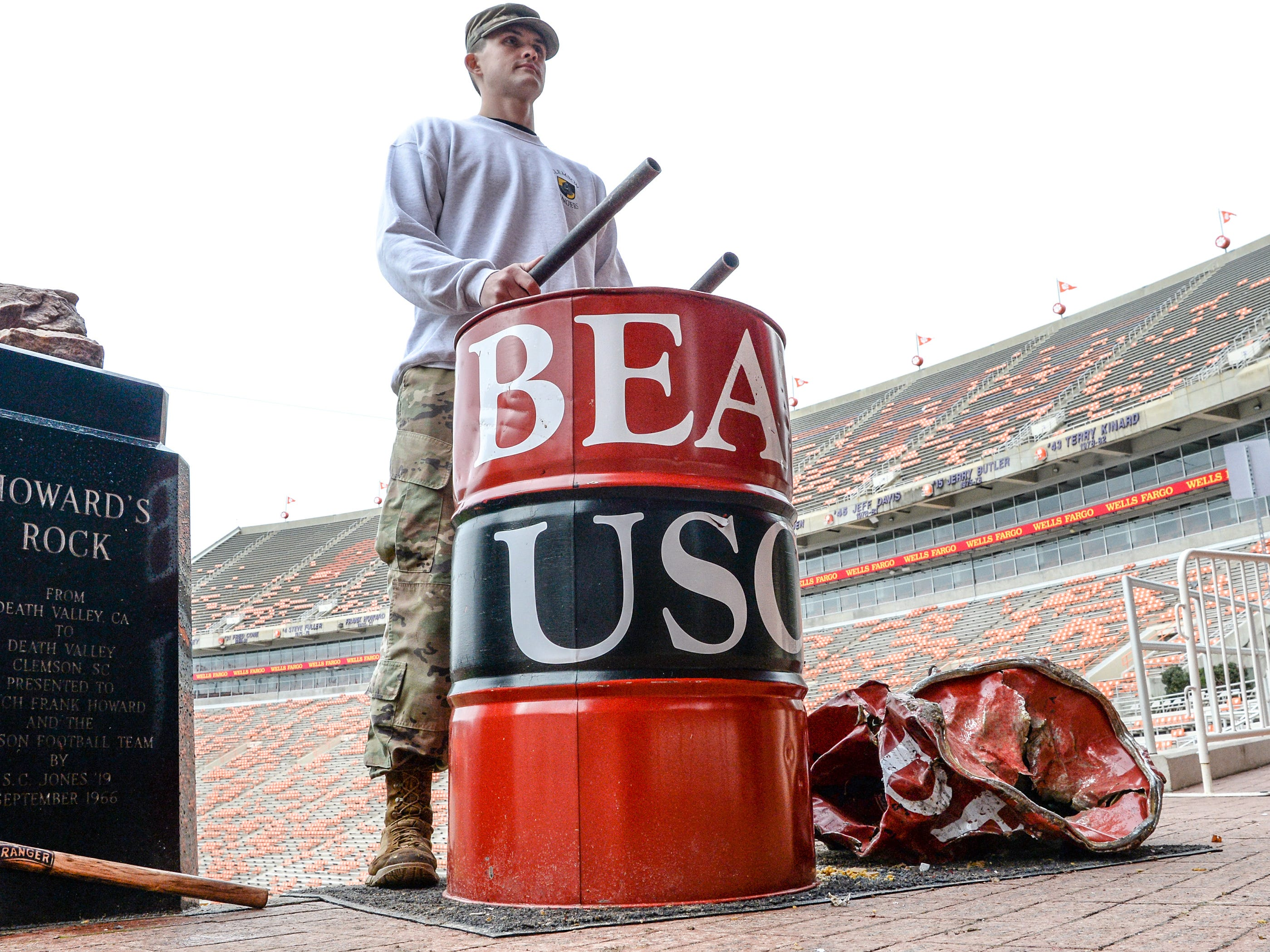 Thomas Mills, a Clemson University junior in Army ROTC and the Clemson Ranger Club, is one of 17 on two-hour shifts banging a steel drum to the ground hours before kickoff in Memorial Stadium, before the South Carolina at Clemson football game in Clemson on Saturday, November 24, 2018.