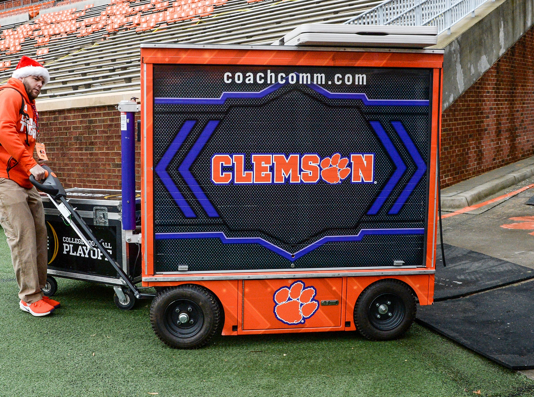 Billy Ruitherford, a Clemson University, brings equipment on the field seven hours before kickoff in Memorial Stadium, before the South Carolina at Clemson football game in Clemson on Saturday, November 24, 2018.