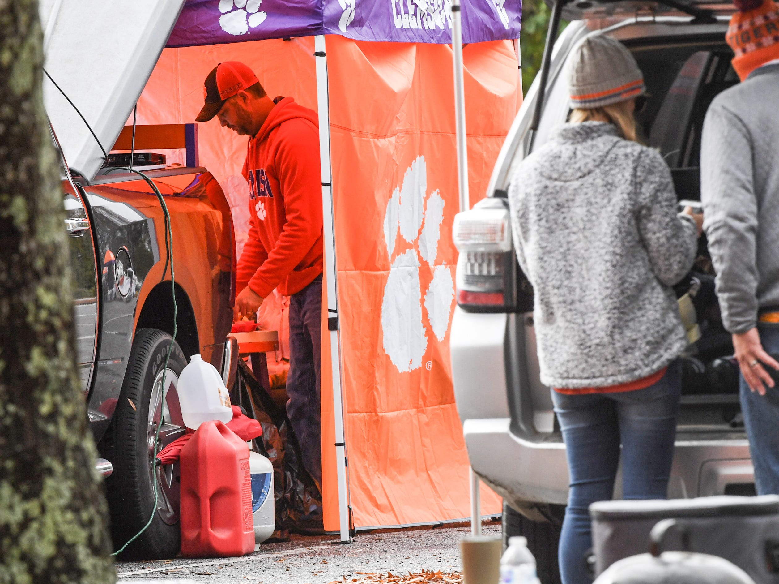 Fans tailgate in a covered area out of the cold, hours before kickoff before the South Carolina at Clemson football game in Clemson on Saturday, November 24, 2018.