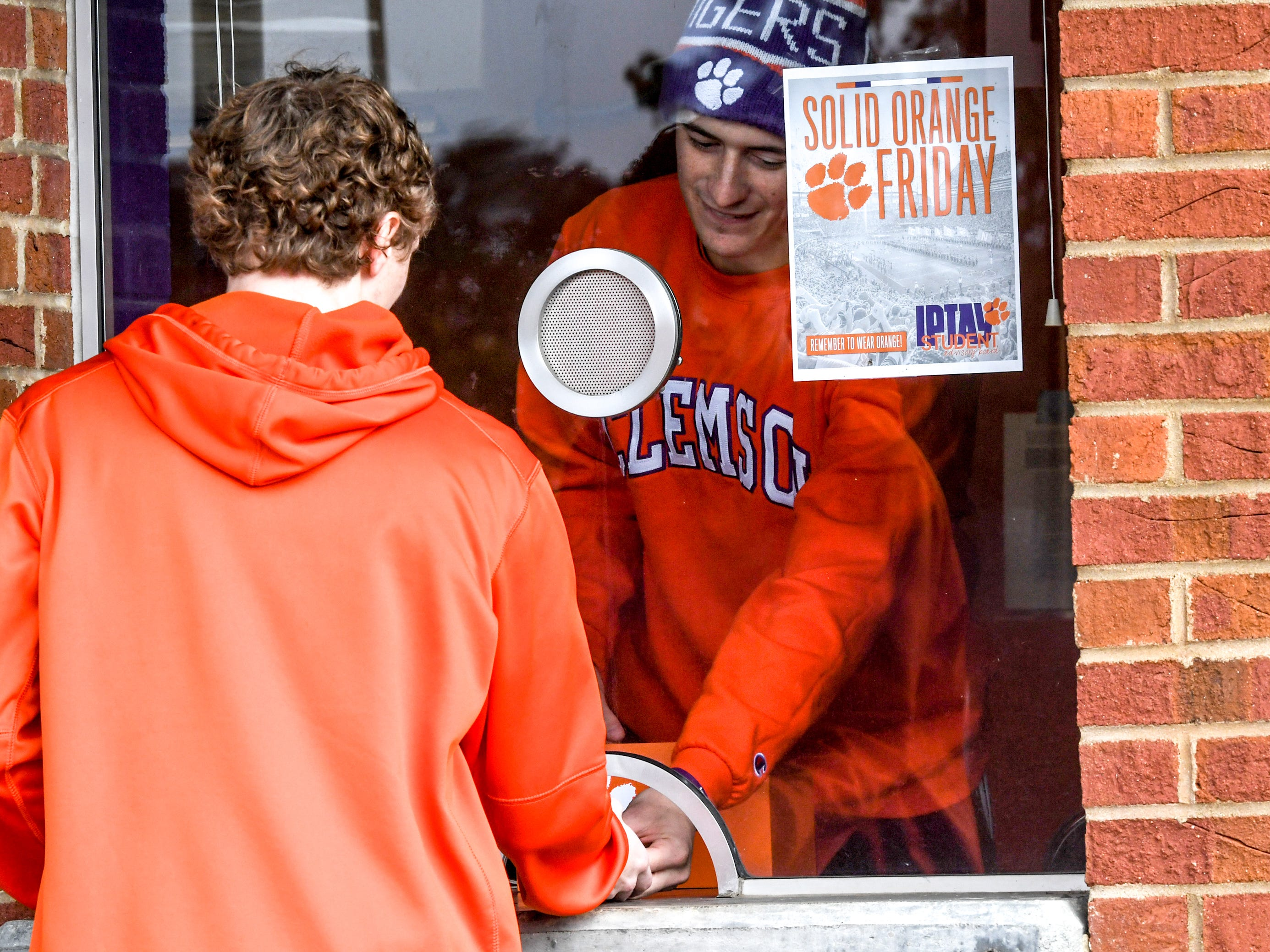 A student arrives to pick up his ticket at will call as fans tailgate hours before kickoff outside Memorial Stadium, before the South Carolina at Clemson football game in Clemson on Saturday, November 24, 2018.