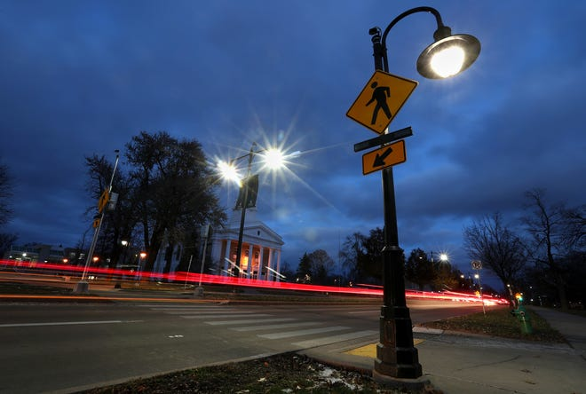 Traffic flows over the crosswalks on College Avenue near Lawrence University.
