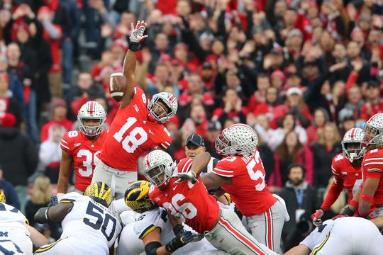 Ohio State Buckeyes defensive end Jonathon Cooper leaps in an attempt to block a field goal block during the first quarter Saturday.