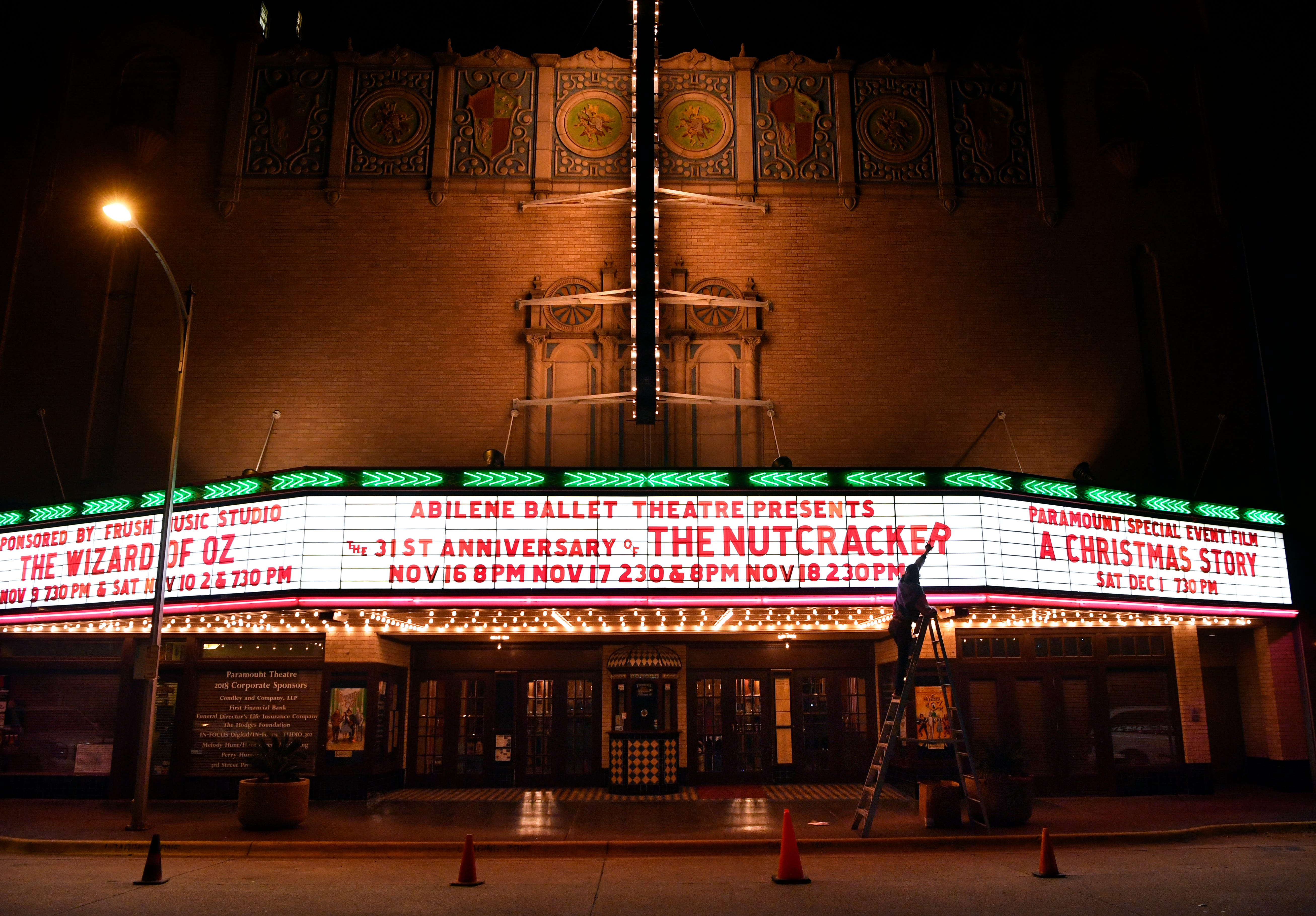 """Corban Gililland hangs the letters on the Paramount Theatre's marquee for """"The Nutcracker."""" The Paramount Theatre has been the centerpiece of downtown since its rebirth in the 1980s."""