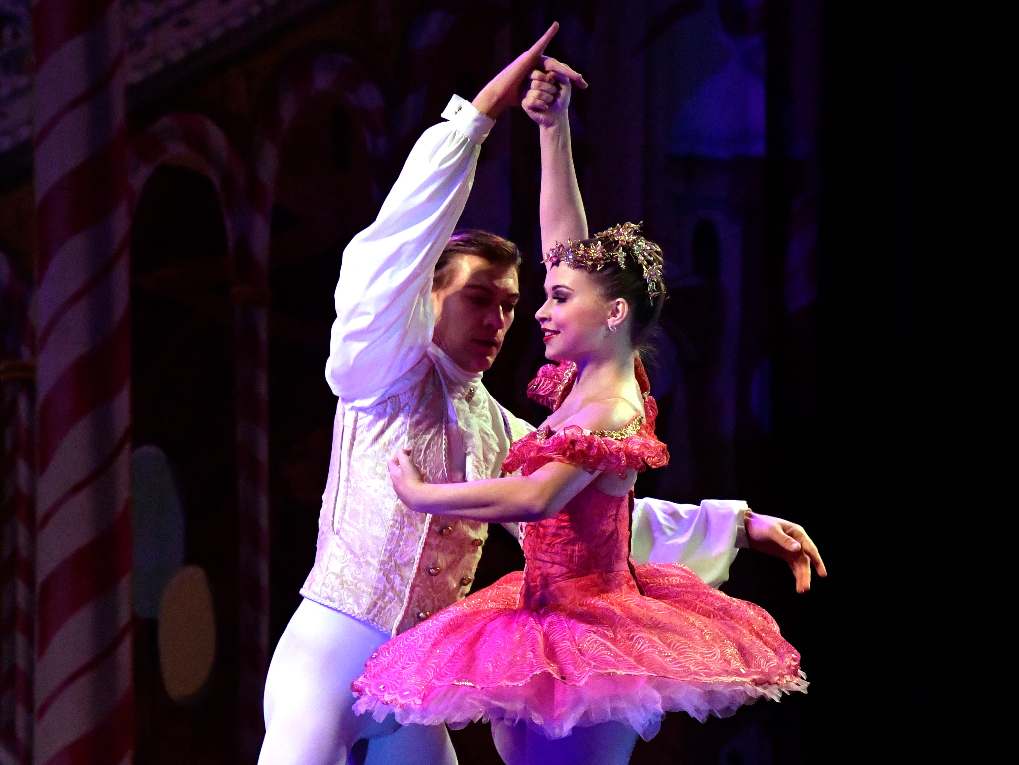 Elizabeth Fillingim as the Sugar Plum Fairy is twirled by Shea Johnson dancing as the Cavalier in the Land of the Sweets scene during Friday's performance of The Nutcracker for schoolchildren Nov. 16, 2018. This was the 31st year for the Abilene Ballet Theatre production, held at the Paramount Theatre.