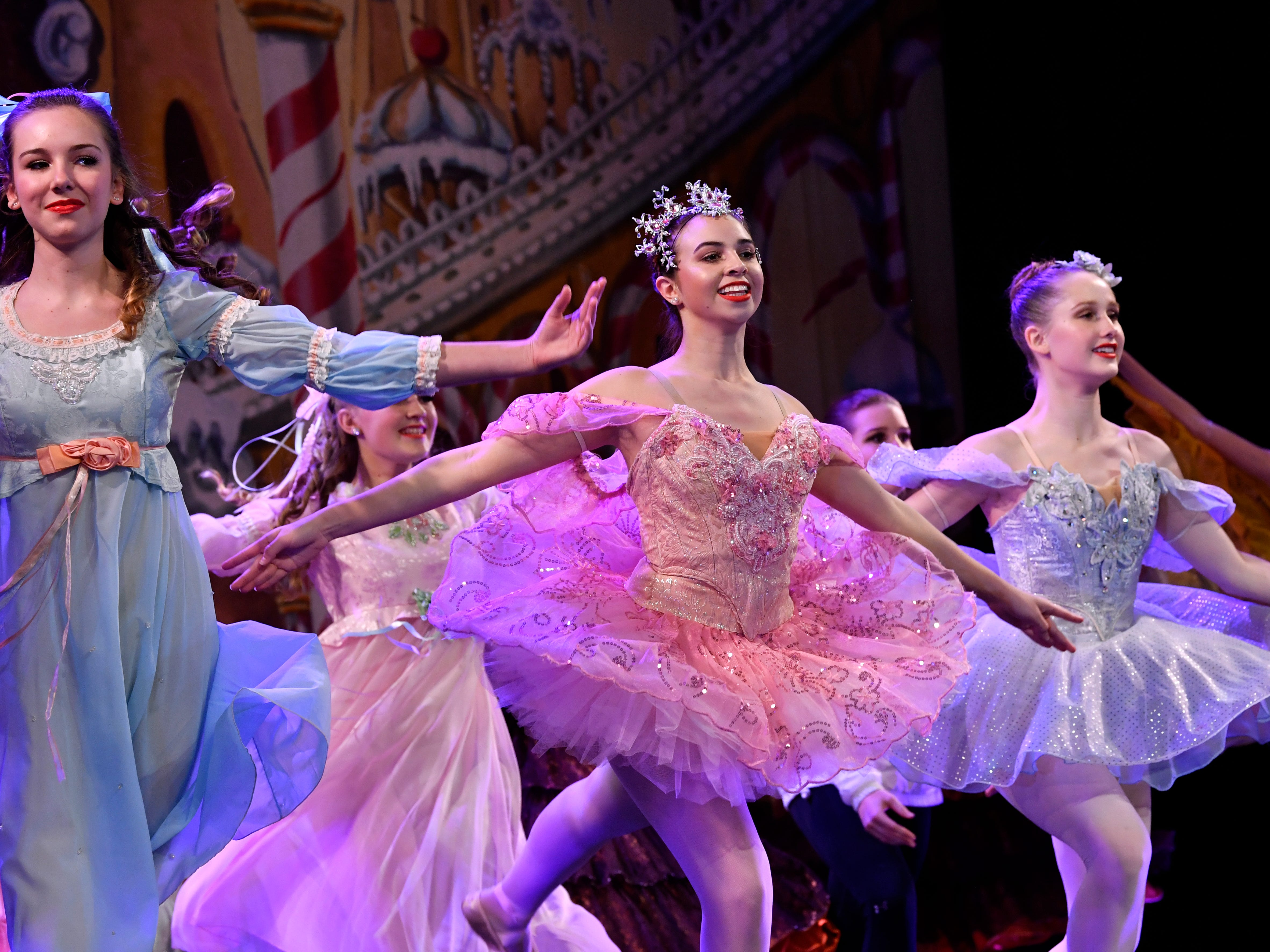 Lily Etter, Dalli Albus and Lydia Longley dance in the Land of the Sweets scene of The Nutcracker during rehearsal Wednesday Nov. 14, 2018. This was the 31st year for the Abilene Ballet Theatre production, held at the Paramount Theatre.