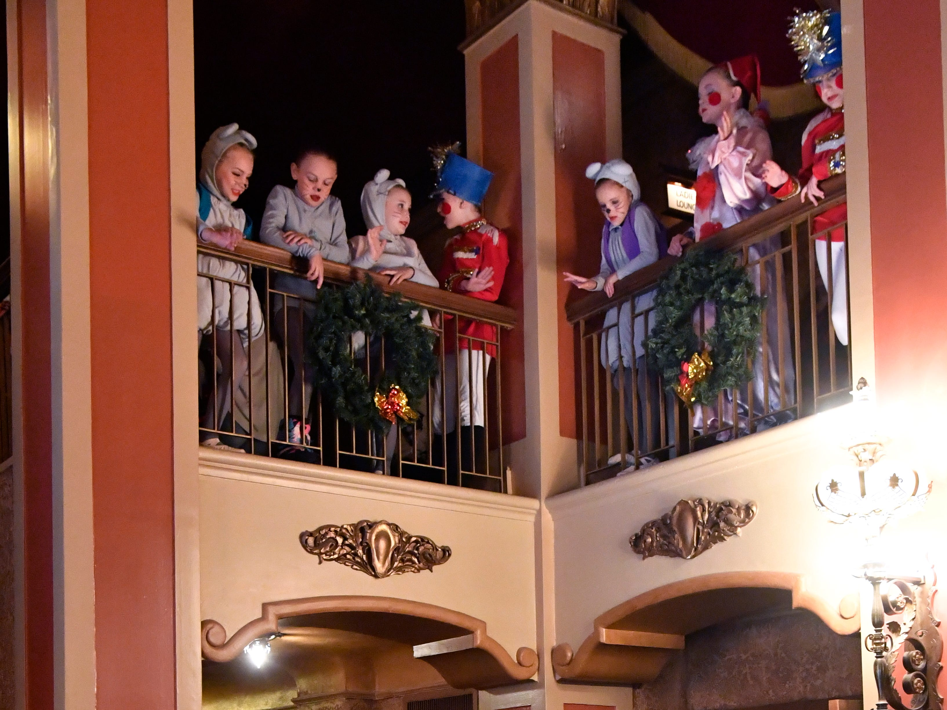 Cast members of The Nutcracker wave to audience members as they depart after Friday's show for schoolchildren Nov. 16, 2018. This was the 31st year for the Abilene Ballet Theatre production, held at the Paramount Theatre.