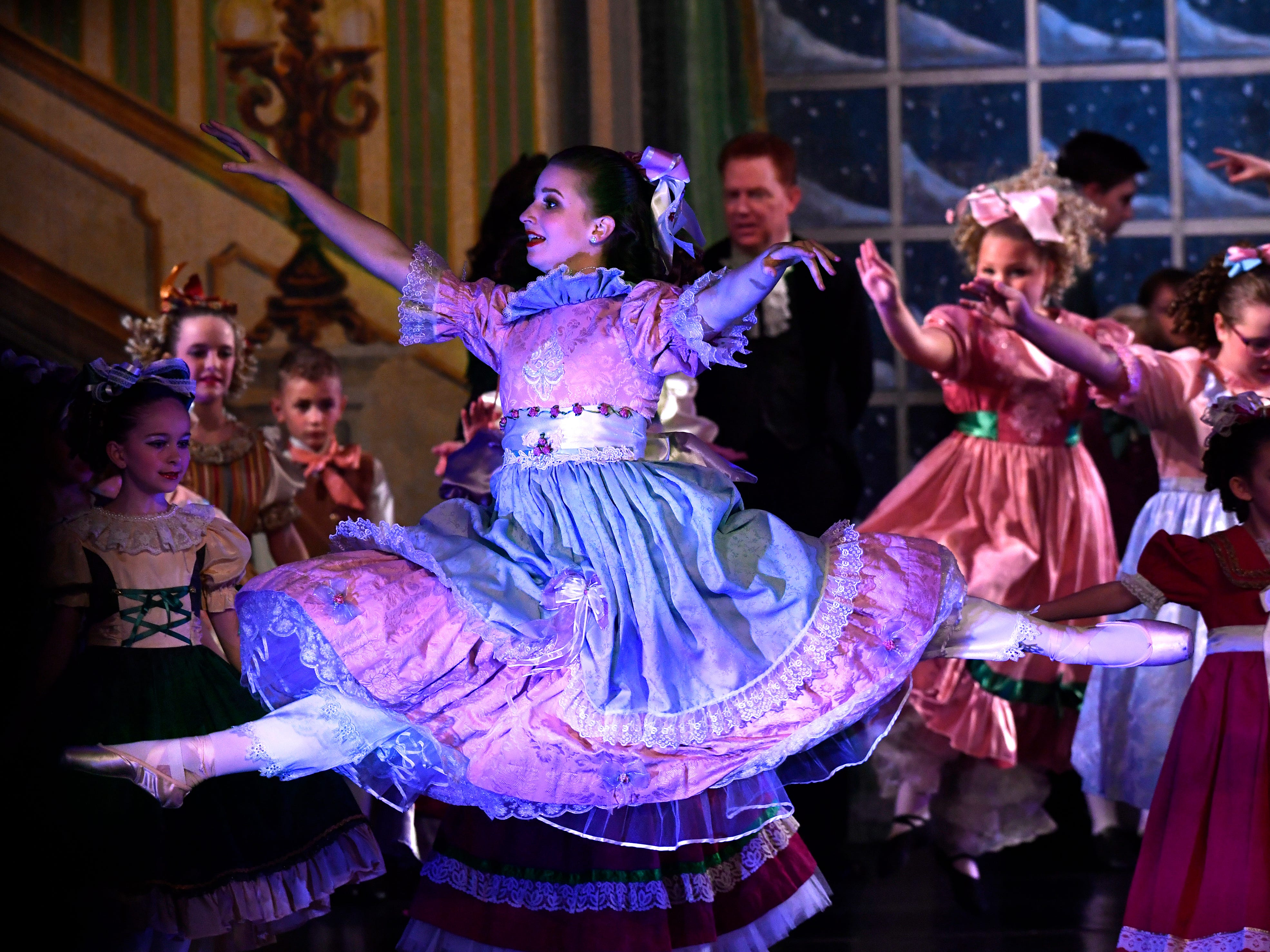 Hope Longley performs as Clara in the Party Scene during a performance of The Nutcracker for schoolchildren Friday Nov. 16, 2018. Three girls played Clara; Lily Etter and Berkley Paul were the other two dancers. This was the 31st year for the Abilene Ballet Theatre production, held at the Paramount Theatre.