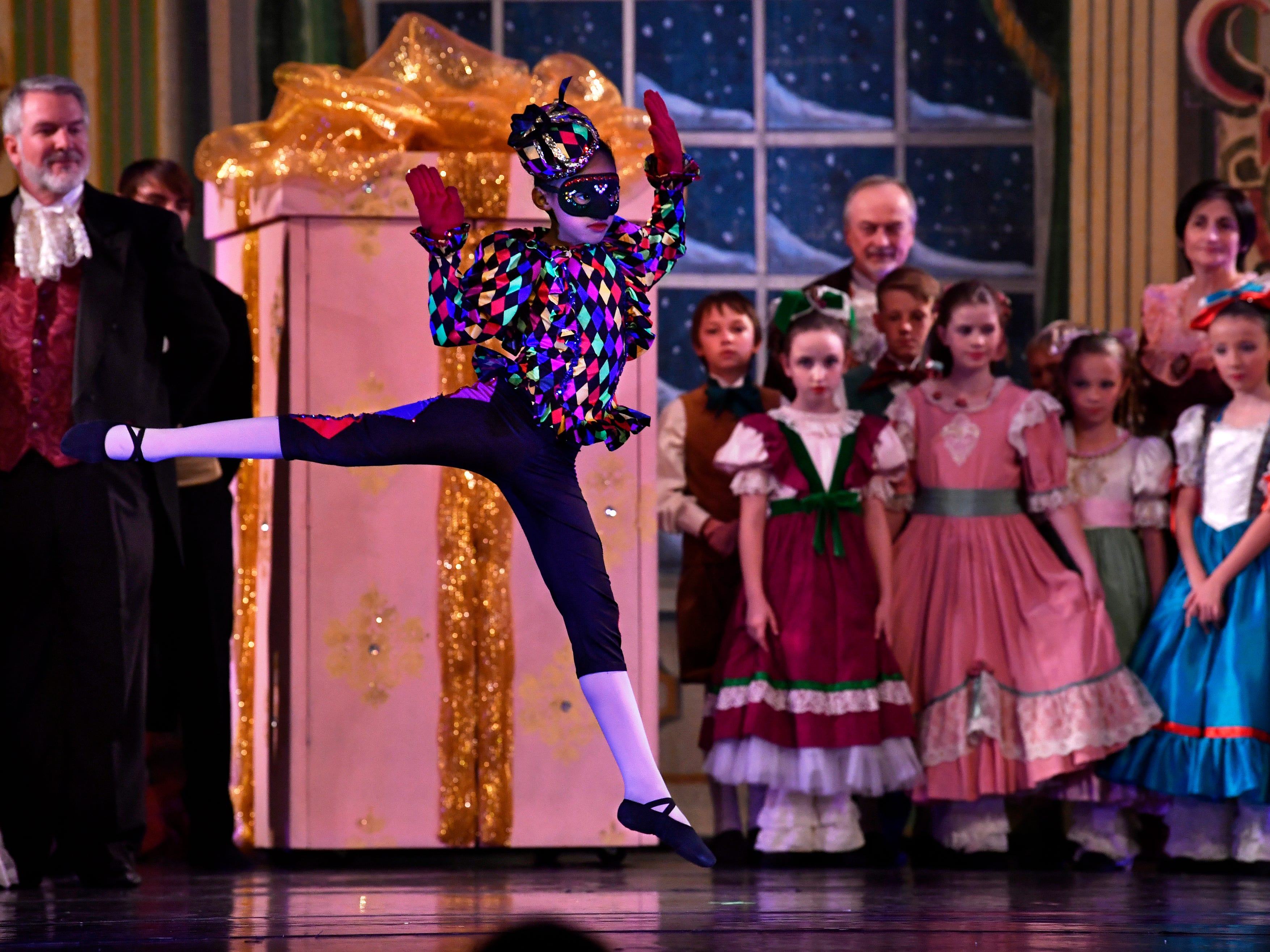 Tia Barnes performs as a mechanical doll during the Party Scene in the final dress rehearsal of The Nutcracker Thursday Nov. 15, 2018. This was the 31st year for the Abilene Ballet Theatre production, held at the Paramount Theatre.