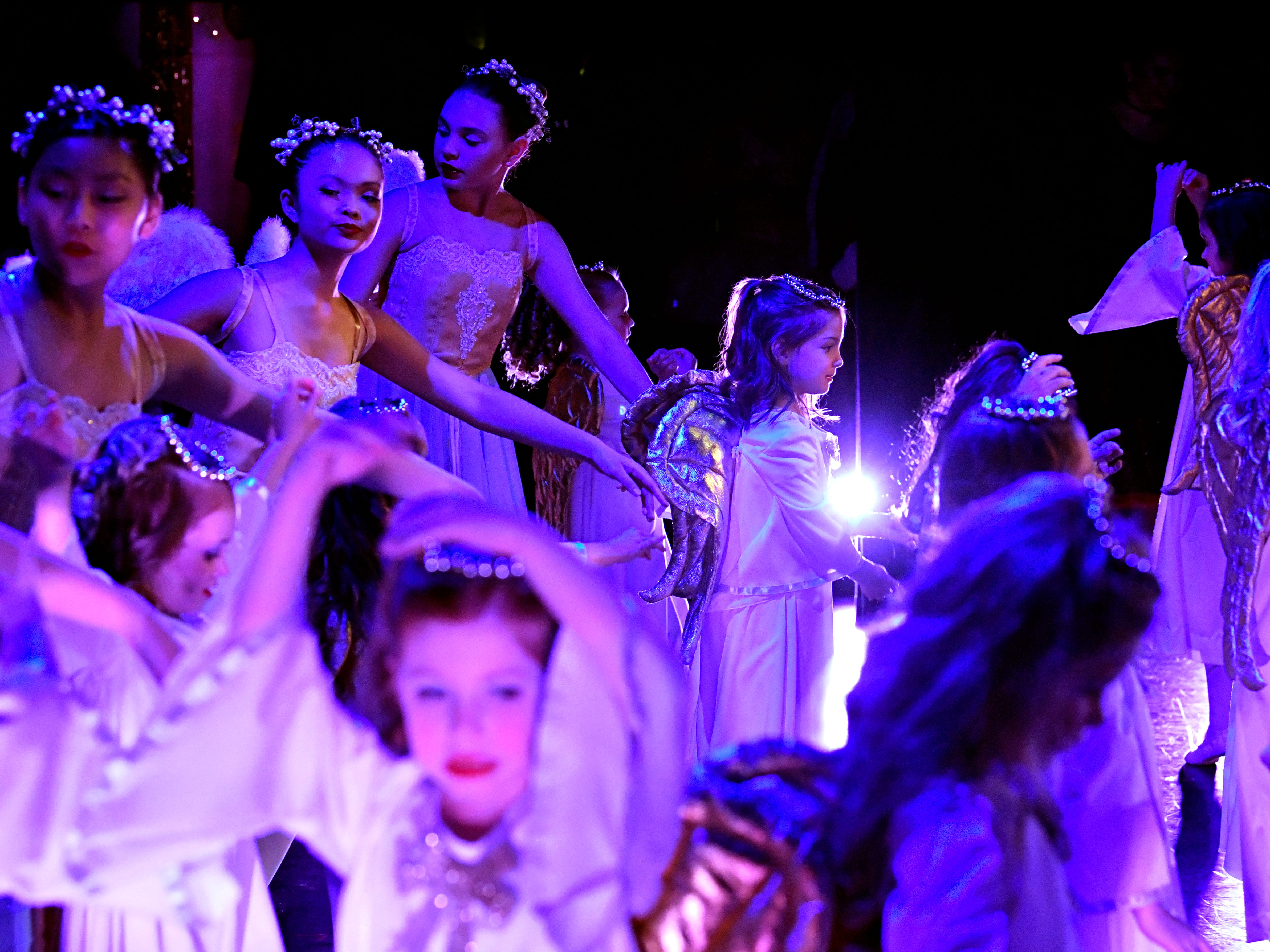 Angels dance during the beginning of Land of the Sweets scene in the Saturday matinee performance of The Nutcracker Nov. 17, 2018. This was the 31st year for the Abilene Ballet Theatre production, held at the Paramount Theatre.