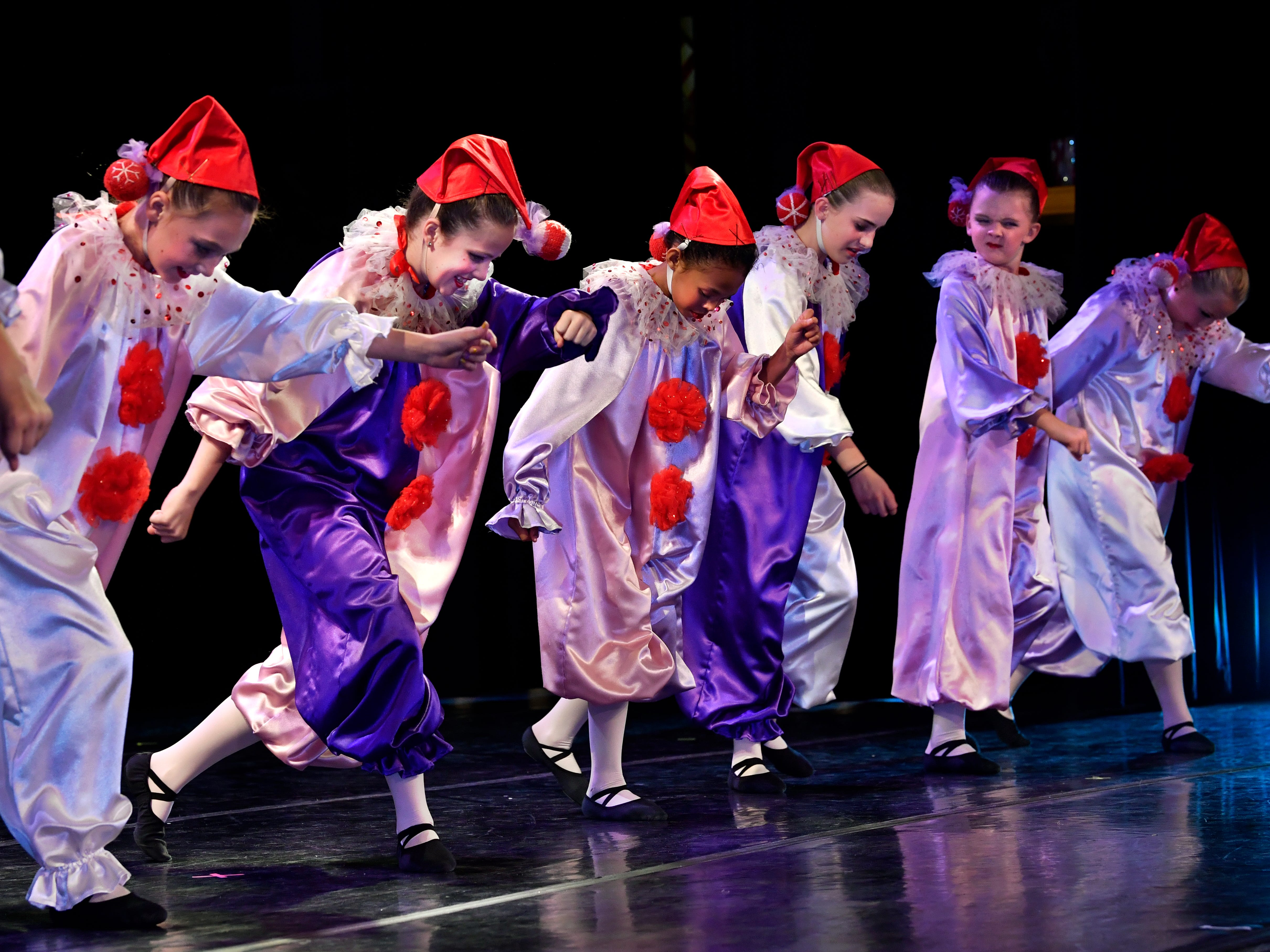 The Polichinelle clowns perform during the Land of the Sweets scene during rehearsal for The Nutcracker Wednesday Nov. 14, 2018. This was the 31st year for the Abilene Ballet Theatre production, held at the Paramount Theatre.