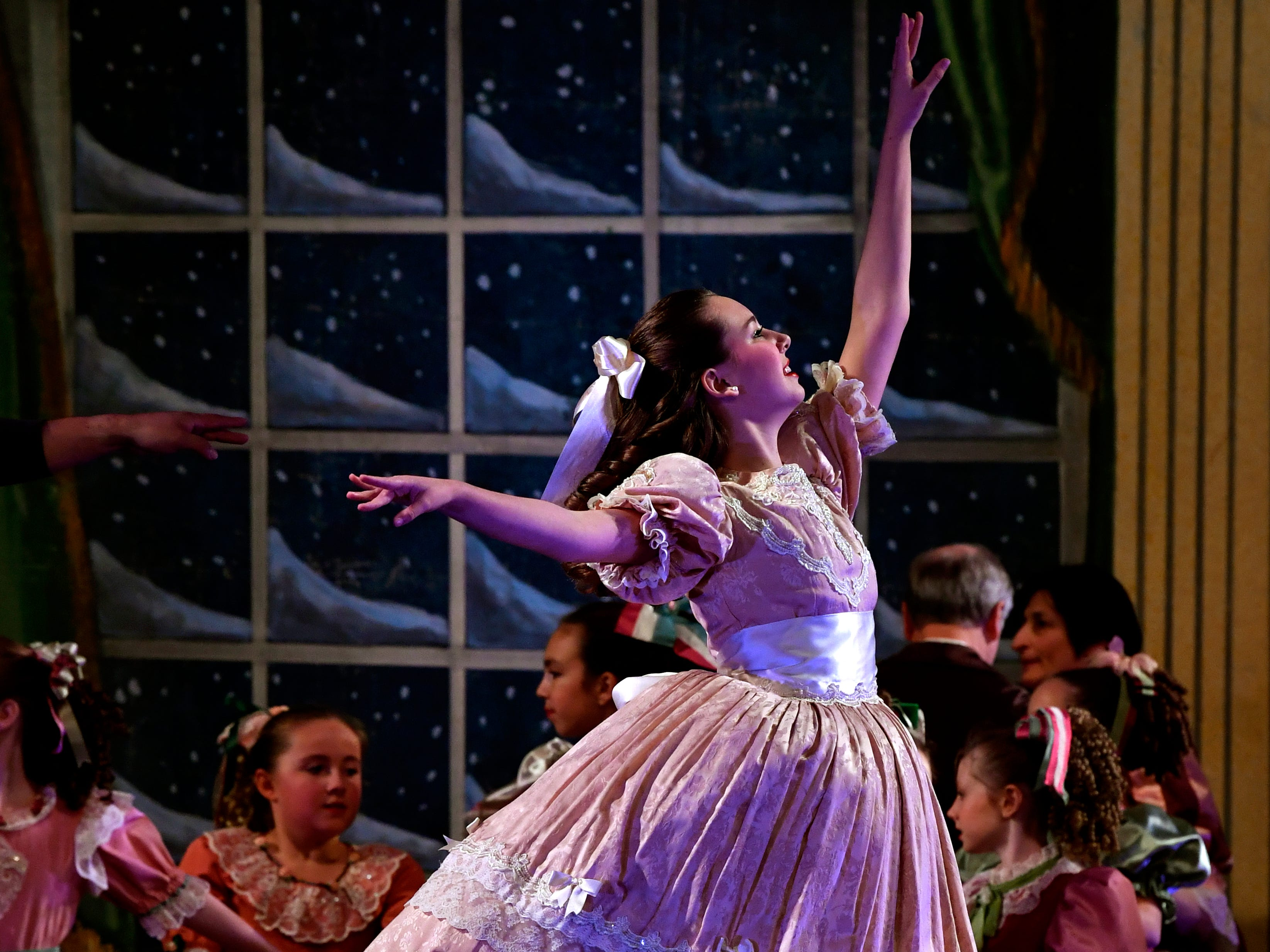 Lily Etter dances as Clara in the Party Scene during the final dress rehearsal of The Nutcracker Thursday Nov. 15, 2018. Three girls played Clara; Hope Longley and Berkley Paul were the other two dancers. This was the 31st year for the Abilene Ballet Theatre production, held at the Paramount Theatre.