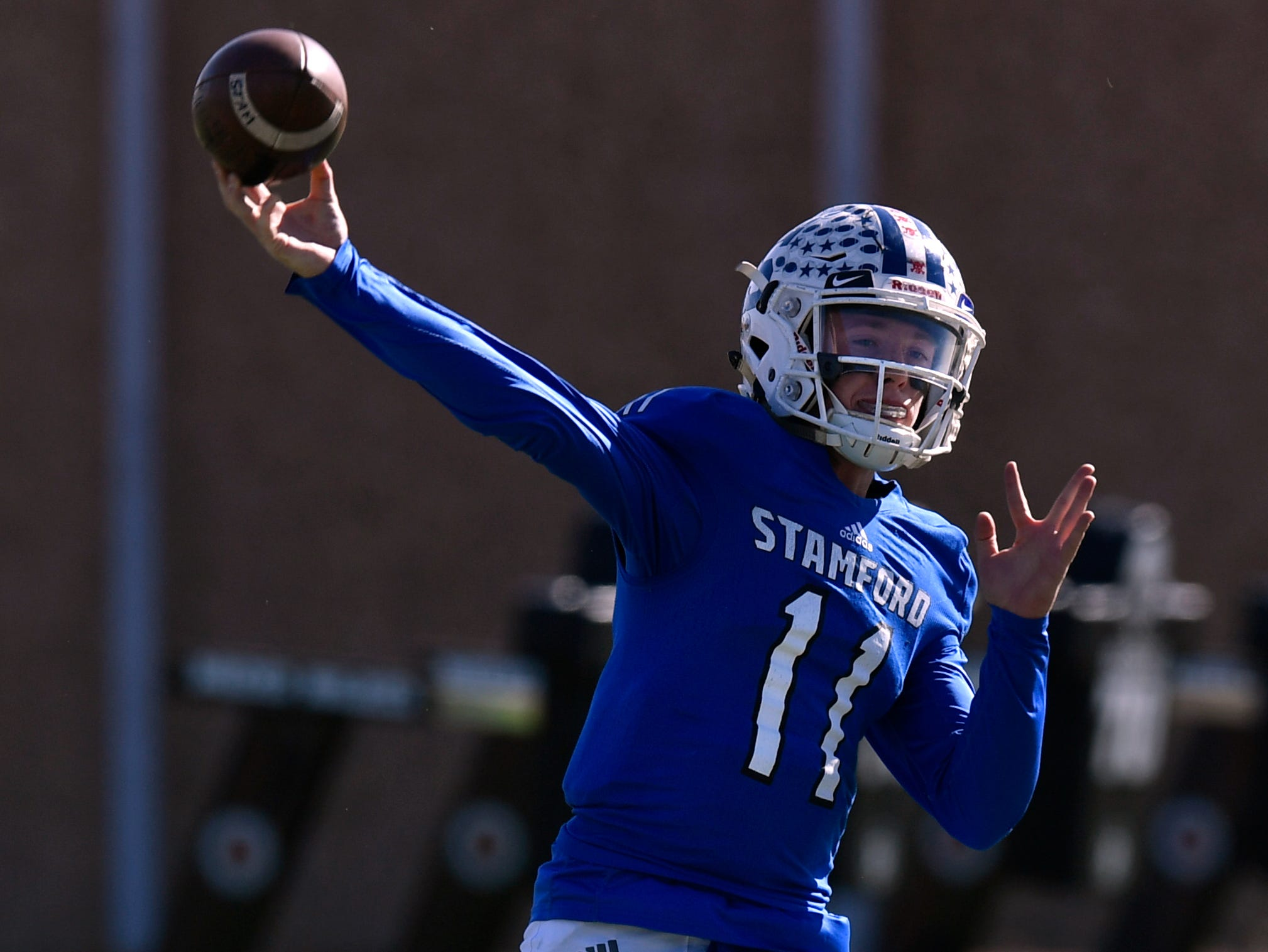 Bulldog quarterback Peyton Bevel passes for Stamford during their playoff game against New Deal in Snyder Friday Nov. 23, 2018. Final score was 64-6, New Deal.