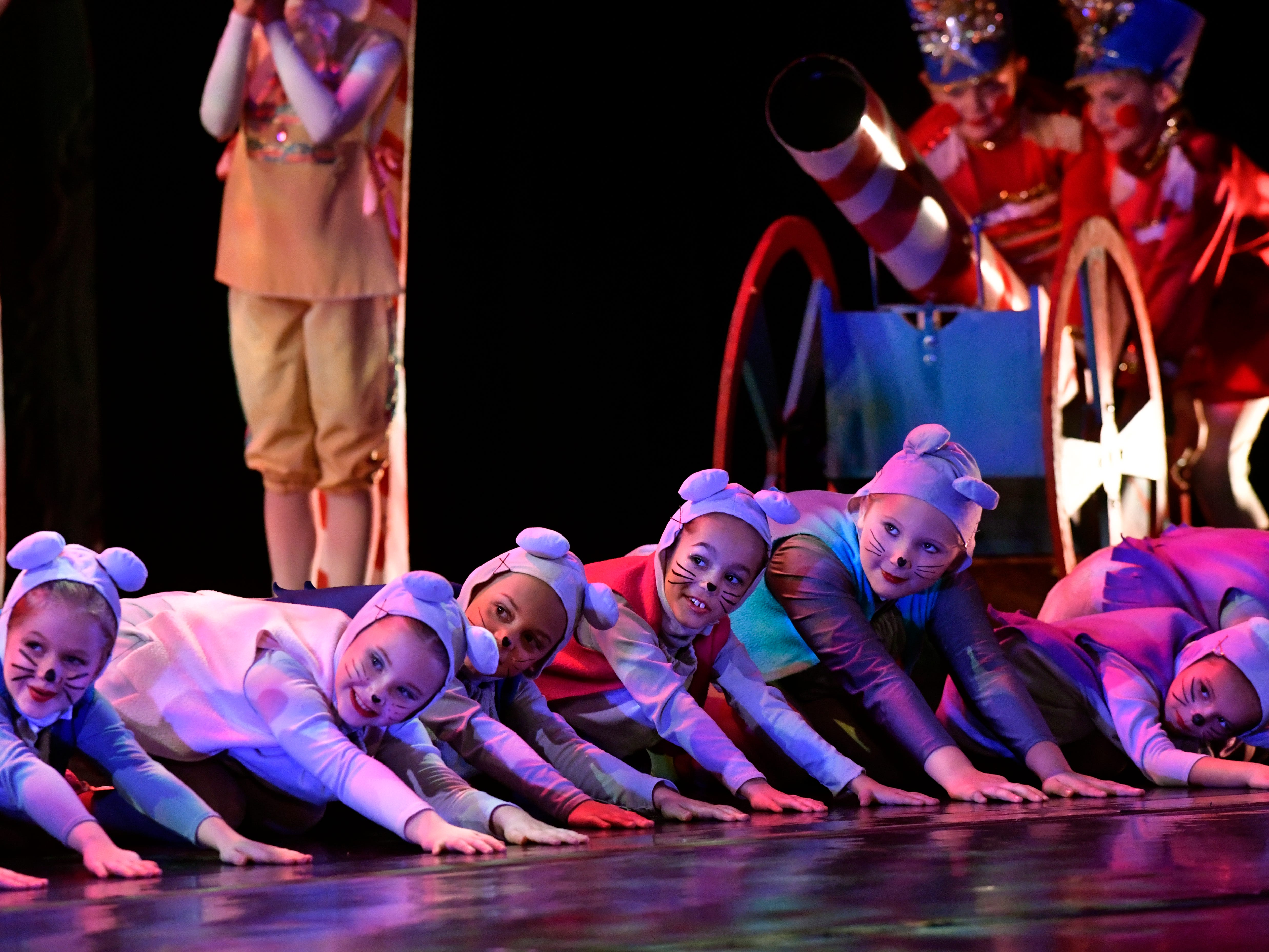 Mice crouch on the floor as the Mouse King prepares to battle the Nutcracker Prince during Friday's performance of The Nutcracker for school children Nov. 16, 2018. This was the 31st year for the Abilene Ballet Theatre production, held at the Paramount Theatre.