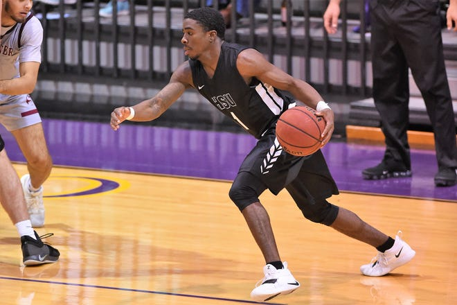 Hardin-Simmons Chris Barrett (1) looks to drive during Saturday's 97-84 win against Schreiner. Barrett, who scored 11 points in the win, and the guards still have a lot of responsibilities for the Cowboys this season, but also have help inside.