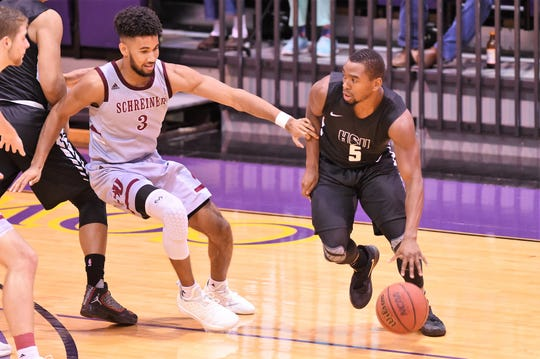 Hardin-Simmons guard Keenan Holdman (5) dribbles around Schreiner defender during Saturday's 97-84 win against Schreiner. Holdman scored 19 points as guard-play will continue to be a key for the Cowboys this season.